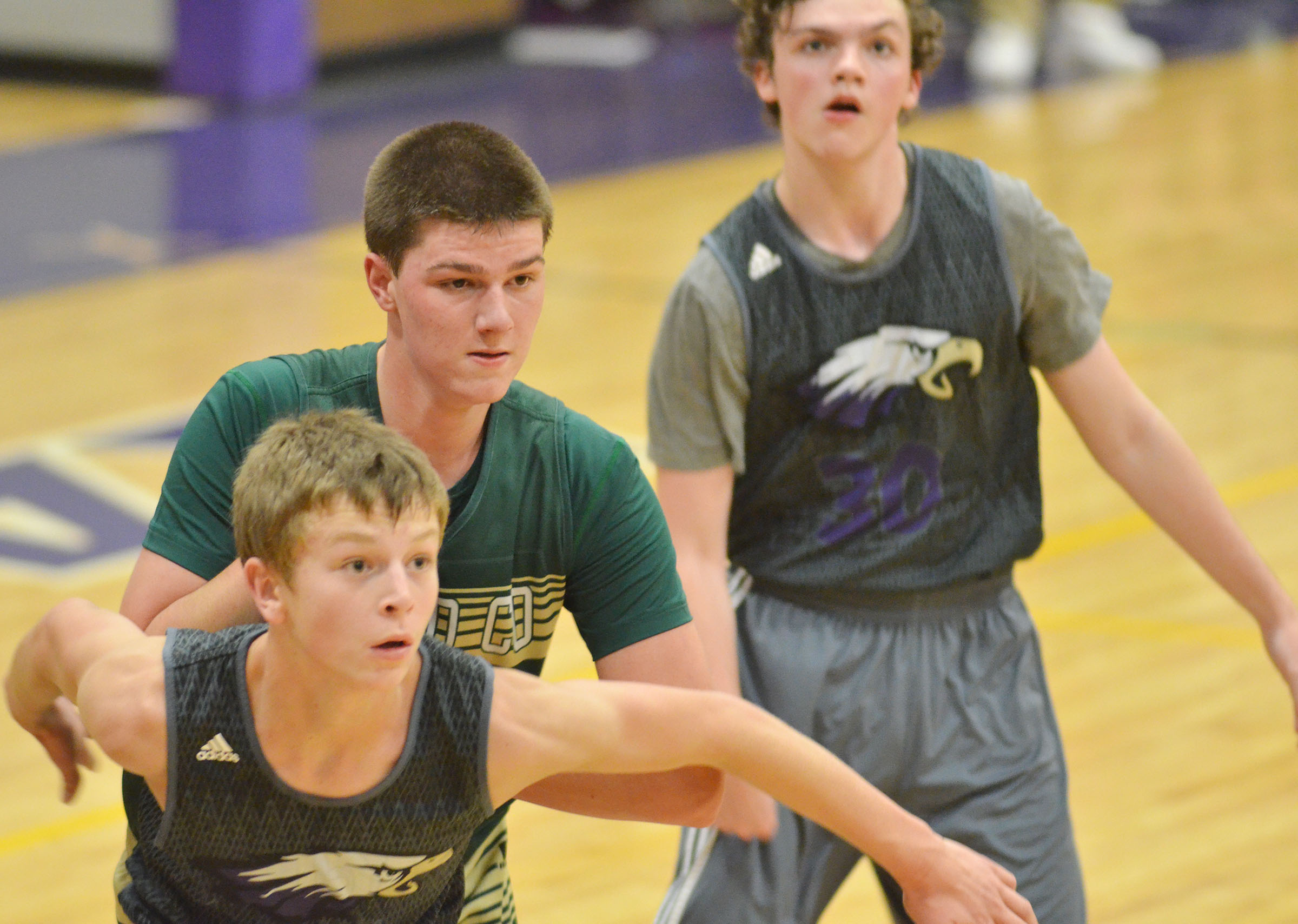 CHS freshmen Noah Hughes, in front, and Jimmy Russell look for a rebound.