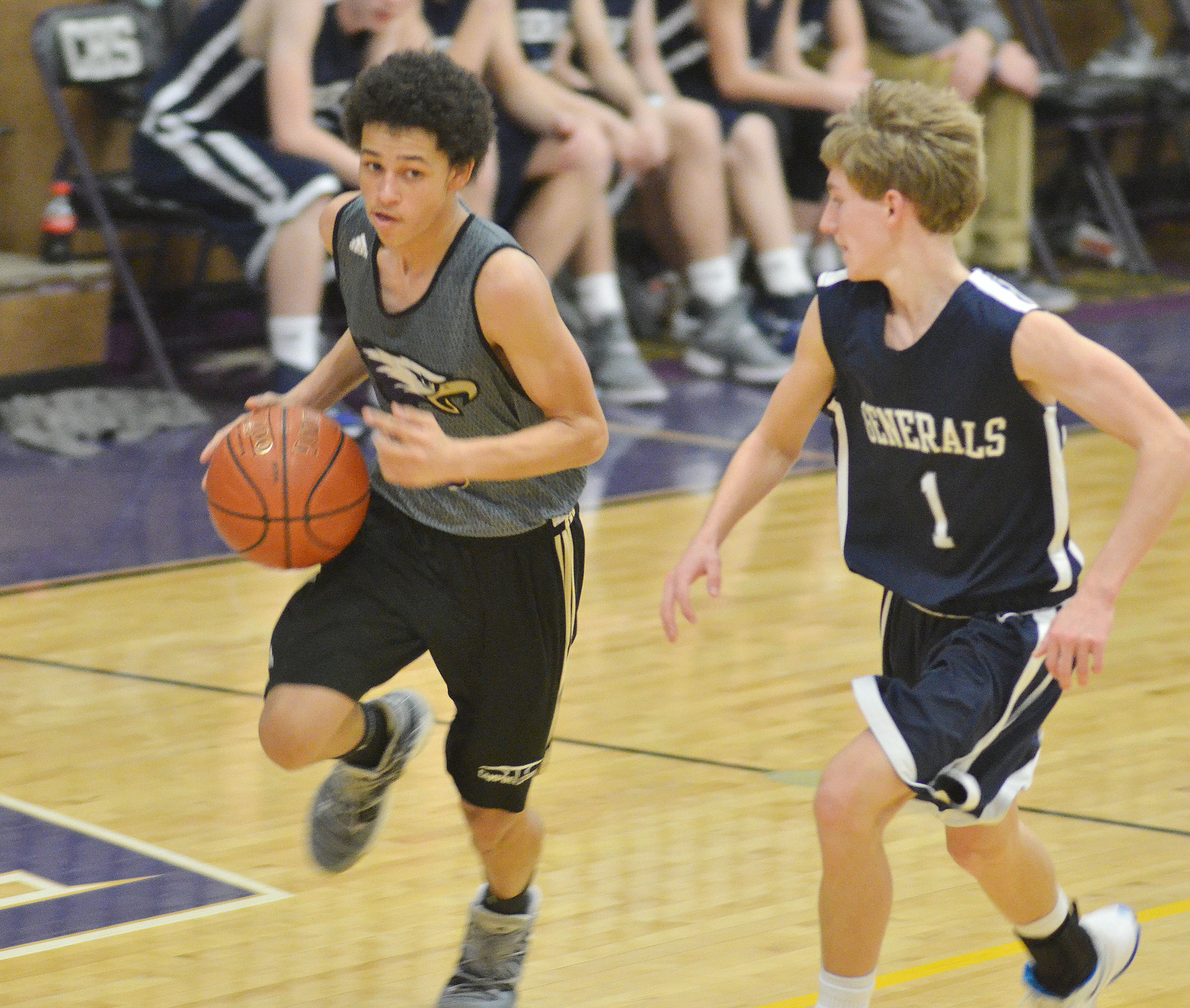 CHS freshman Mikael Vaught dribbles to the hoop.