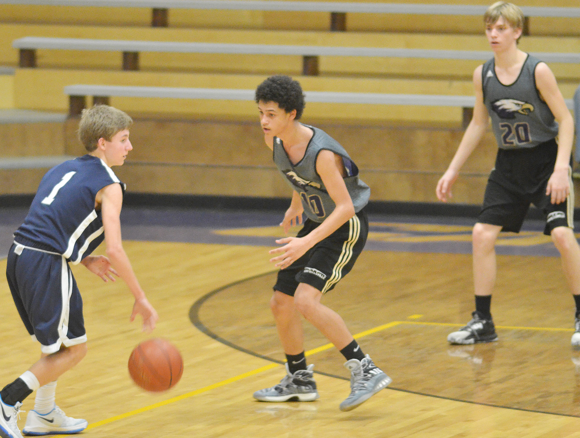 CHS freshman Mikael Vaught, center, and Campbellsville Middle School eighth-grader Arren Hash play defense.