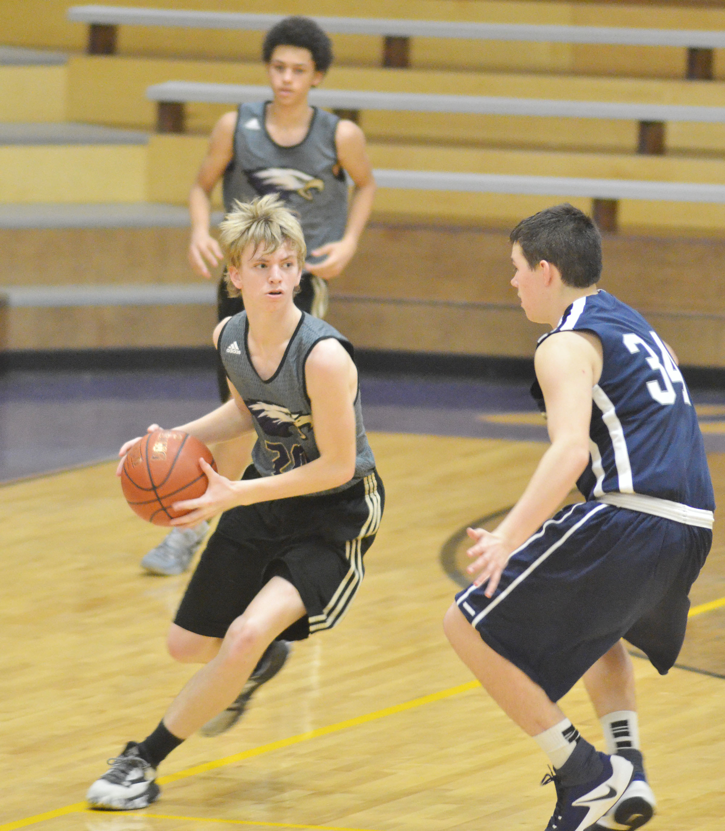 Campbellsville Middle School eighth-grader Arren Hash dribbles down the court.