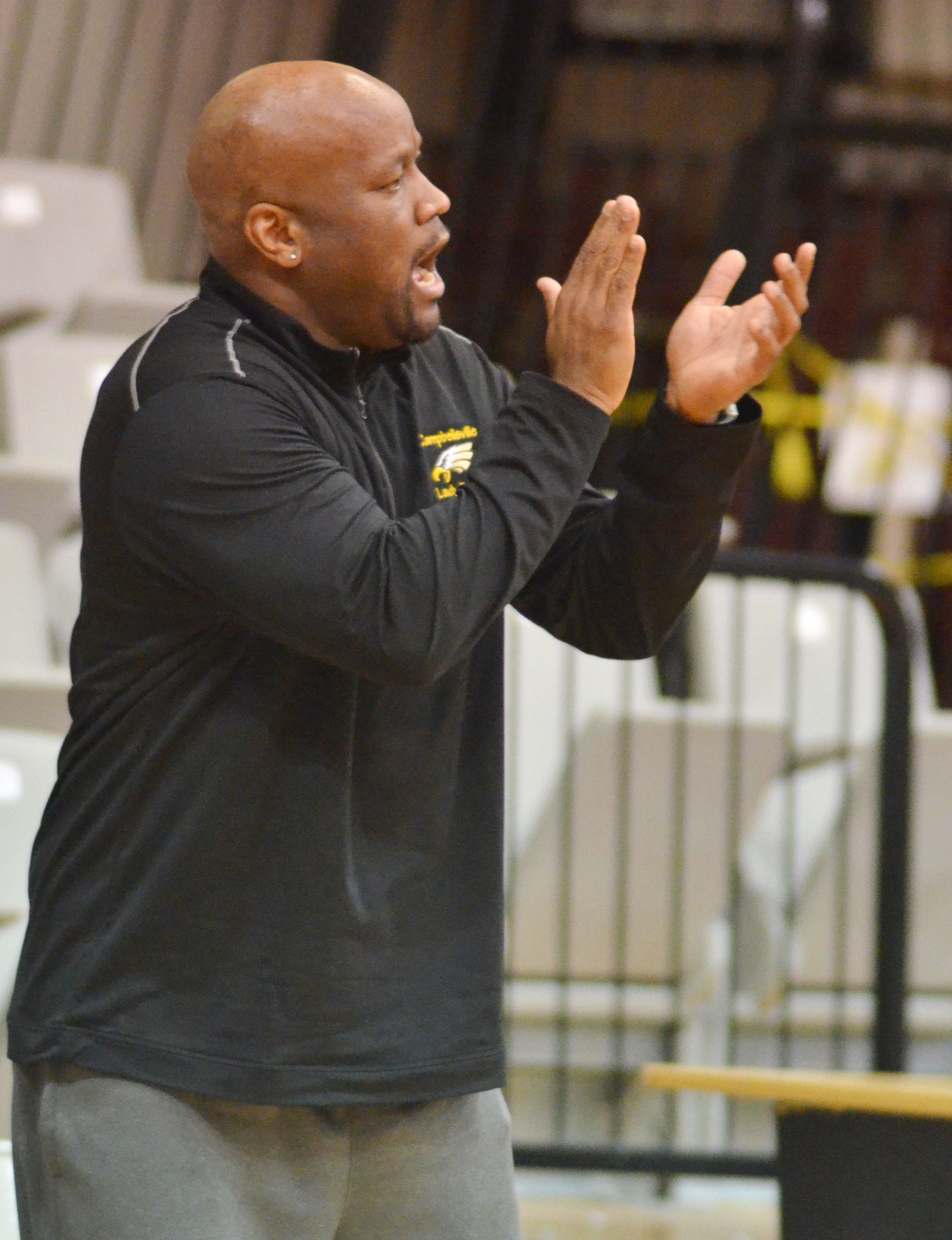 CHS girls' basketball head coach Anthony Epps cheers for his team.