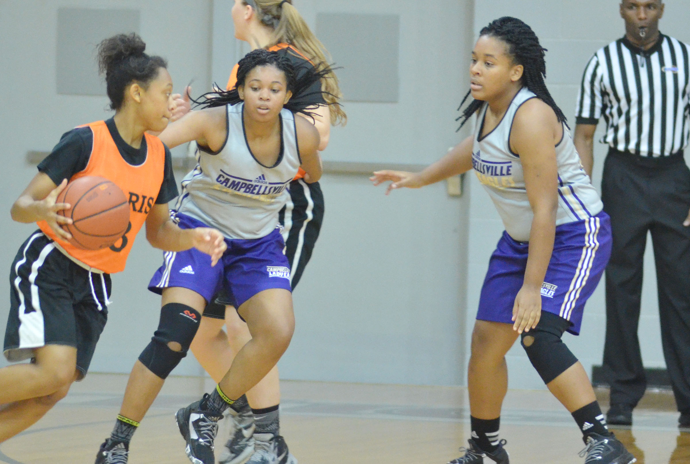 CHS juniors Vonnea Smith, at left, and Kayla Young play defense.