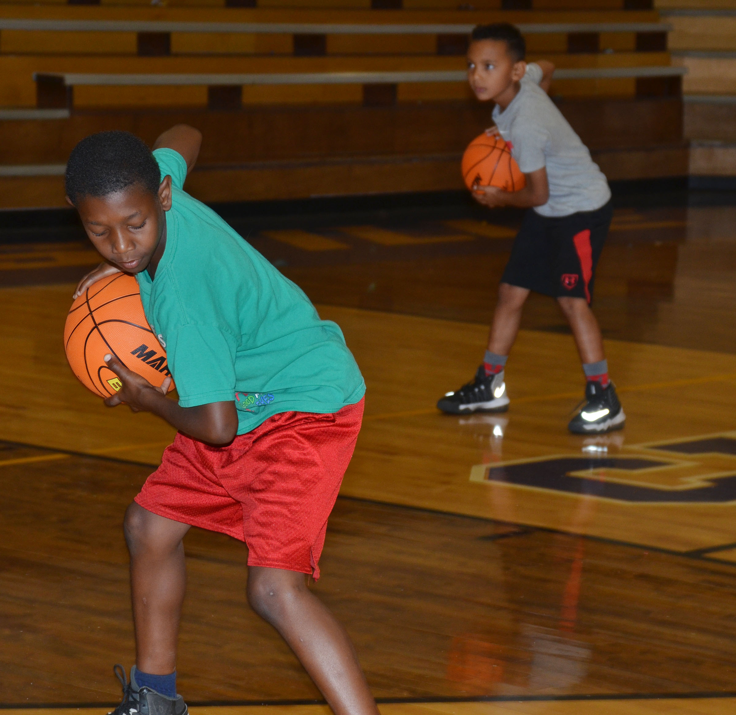 Jaron Johnson, at left, and Maddox Hawkins practice ball handling.