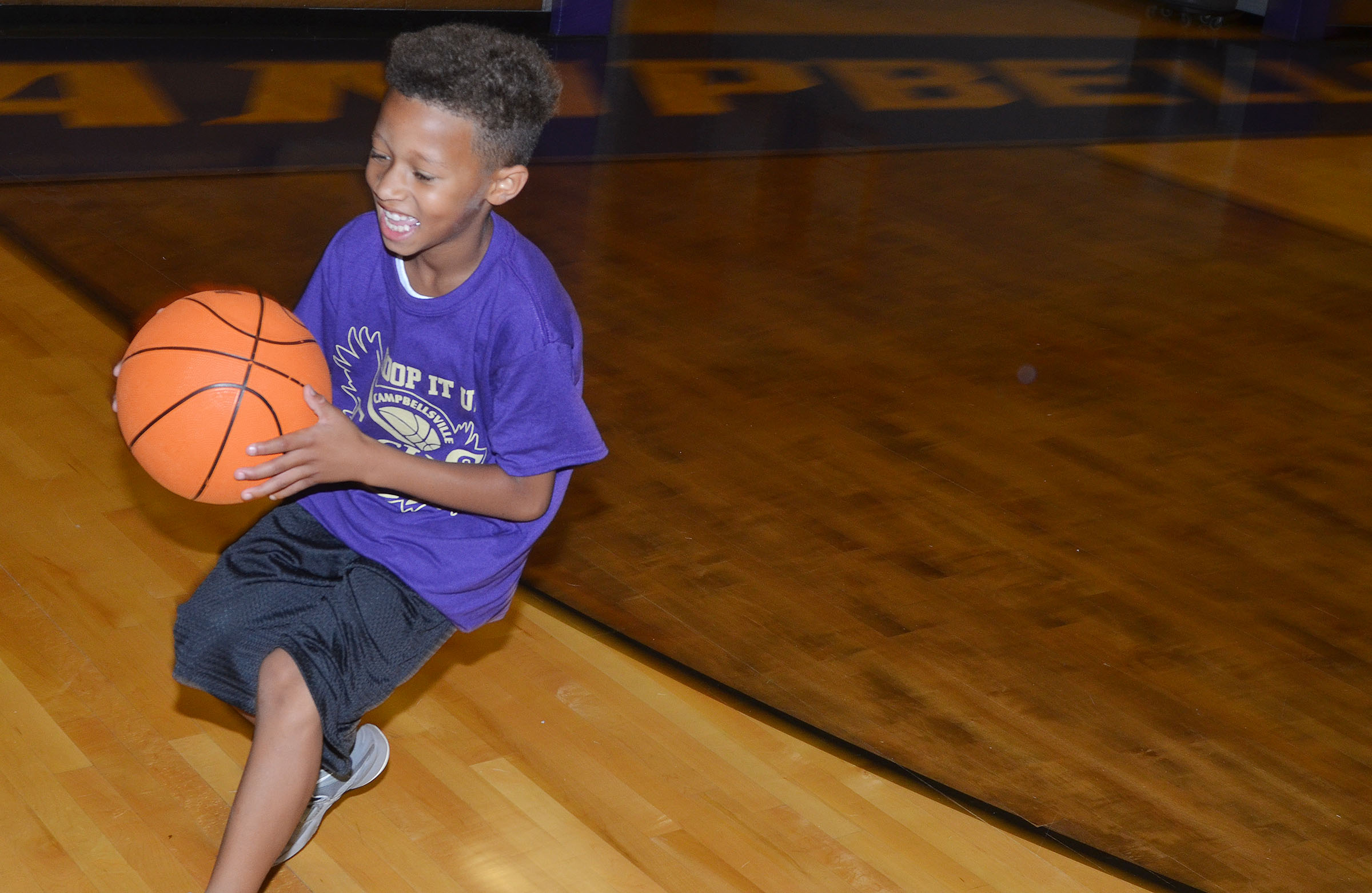 Rajon Taylor practices dribbling.