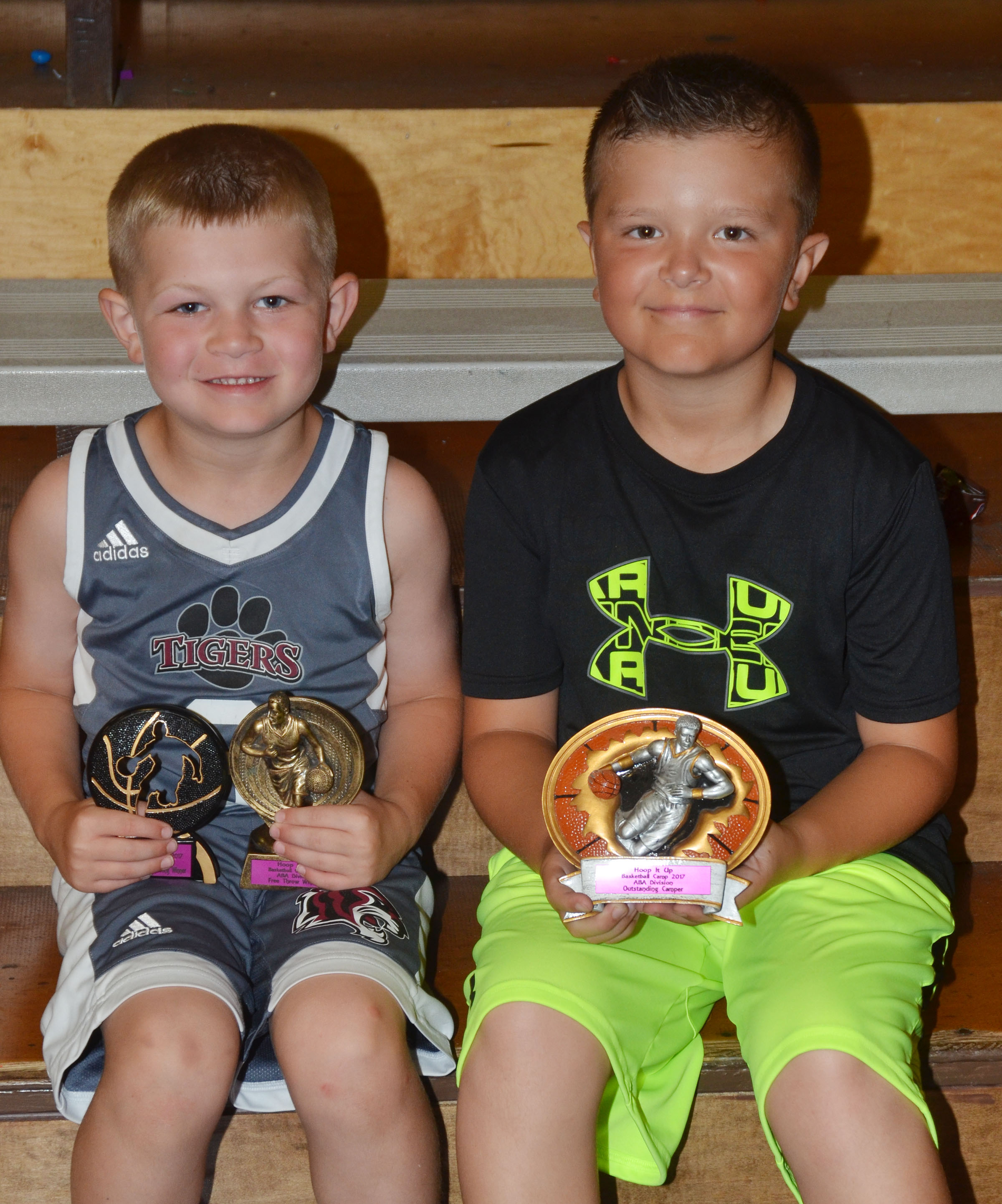 Griff Thomas, at left, won camp awards in the ABA division for free throws and competition shooting. Cayton Lawhorn won the outstanding camper award.