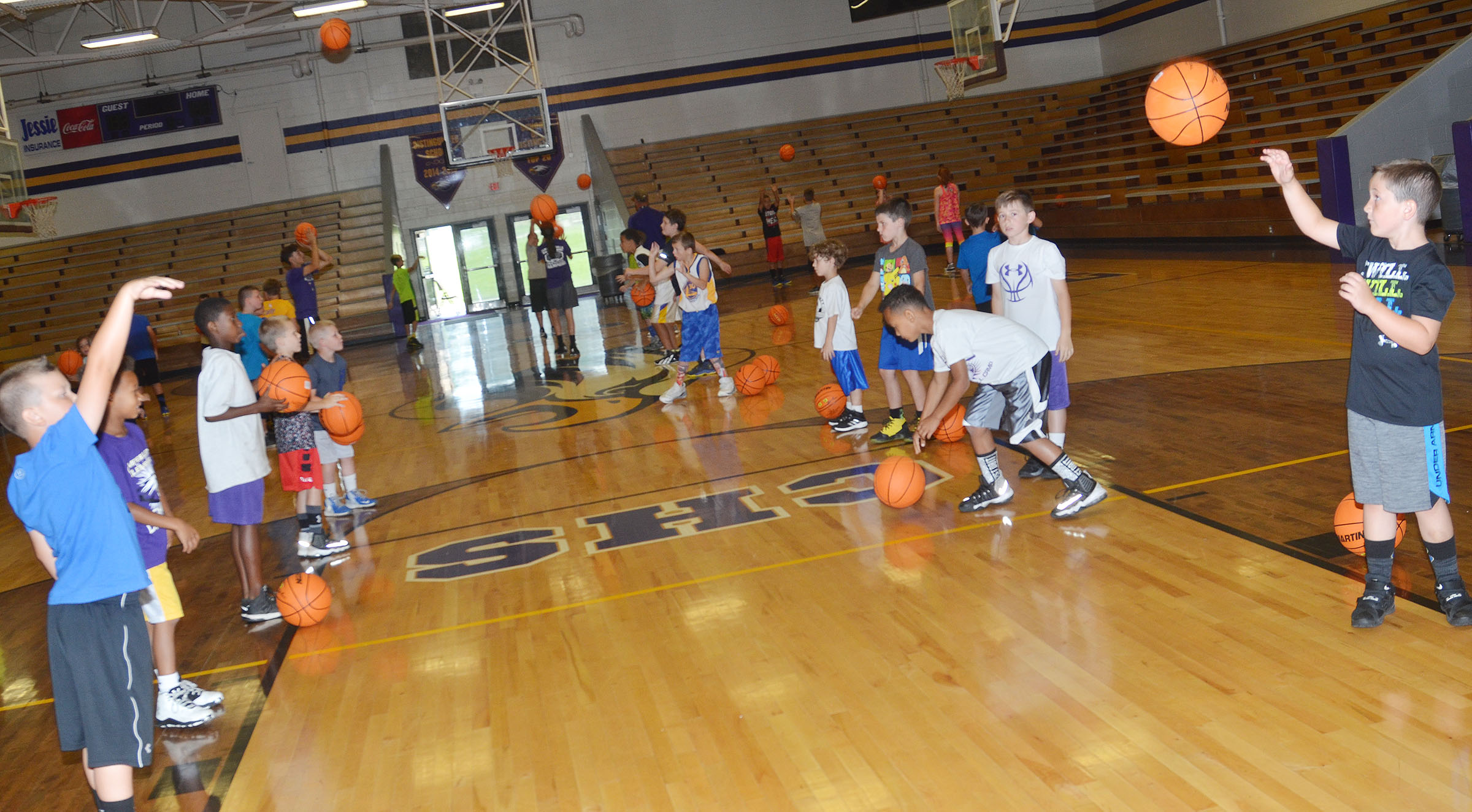 CHS Hoop It Up campers practice shooting.