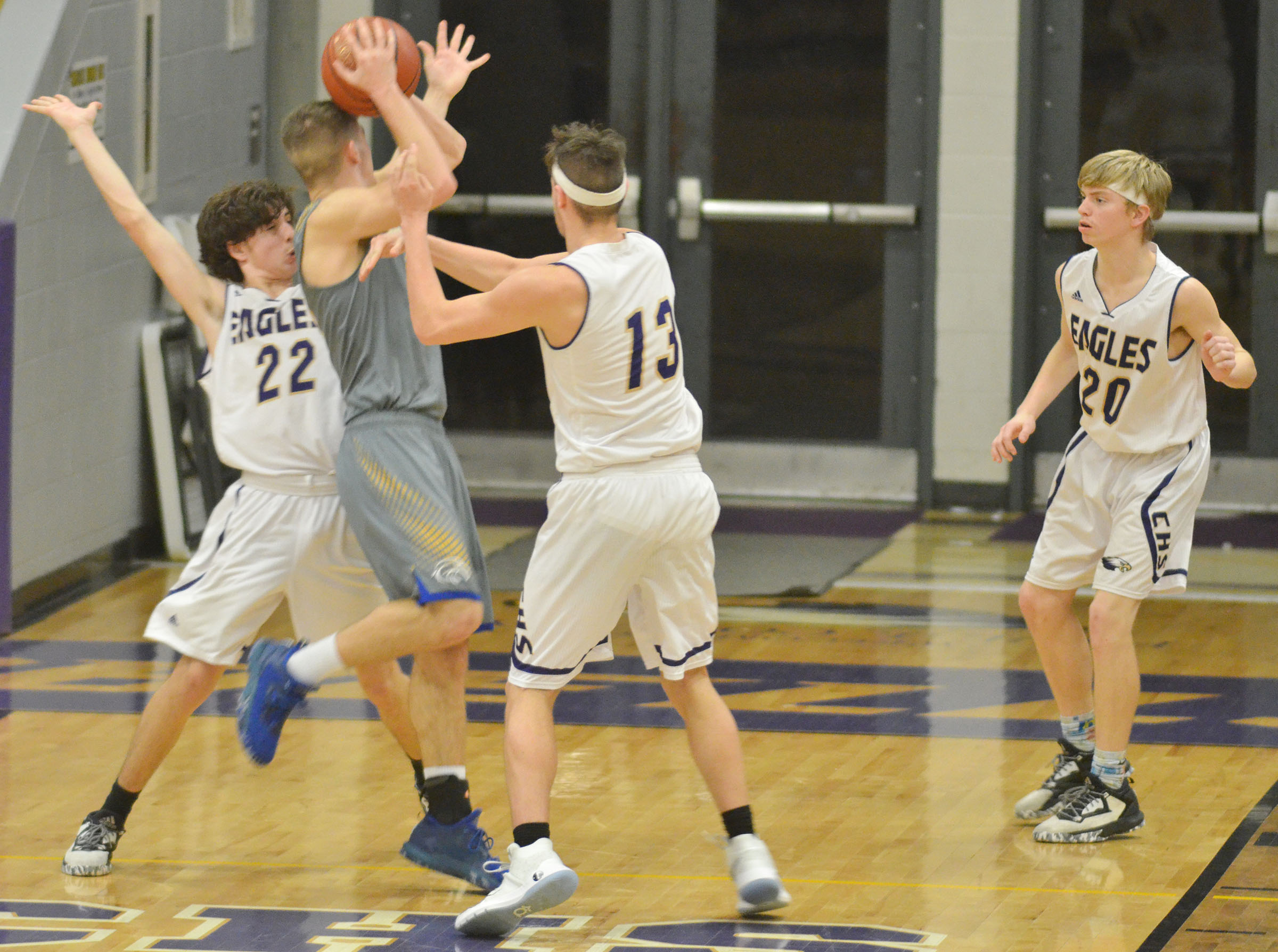 Campbellsville Middle School eighth-grader John Orberson, at left, and Logan Cole, center, block a shot.