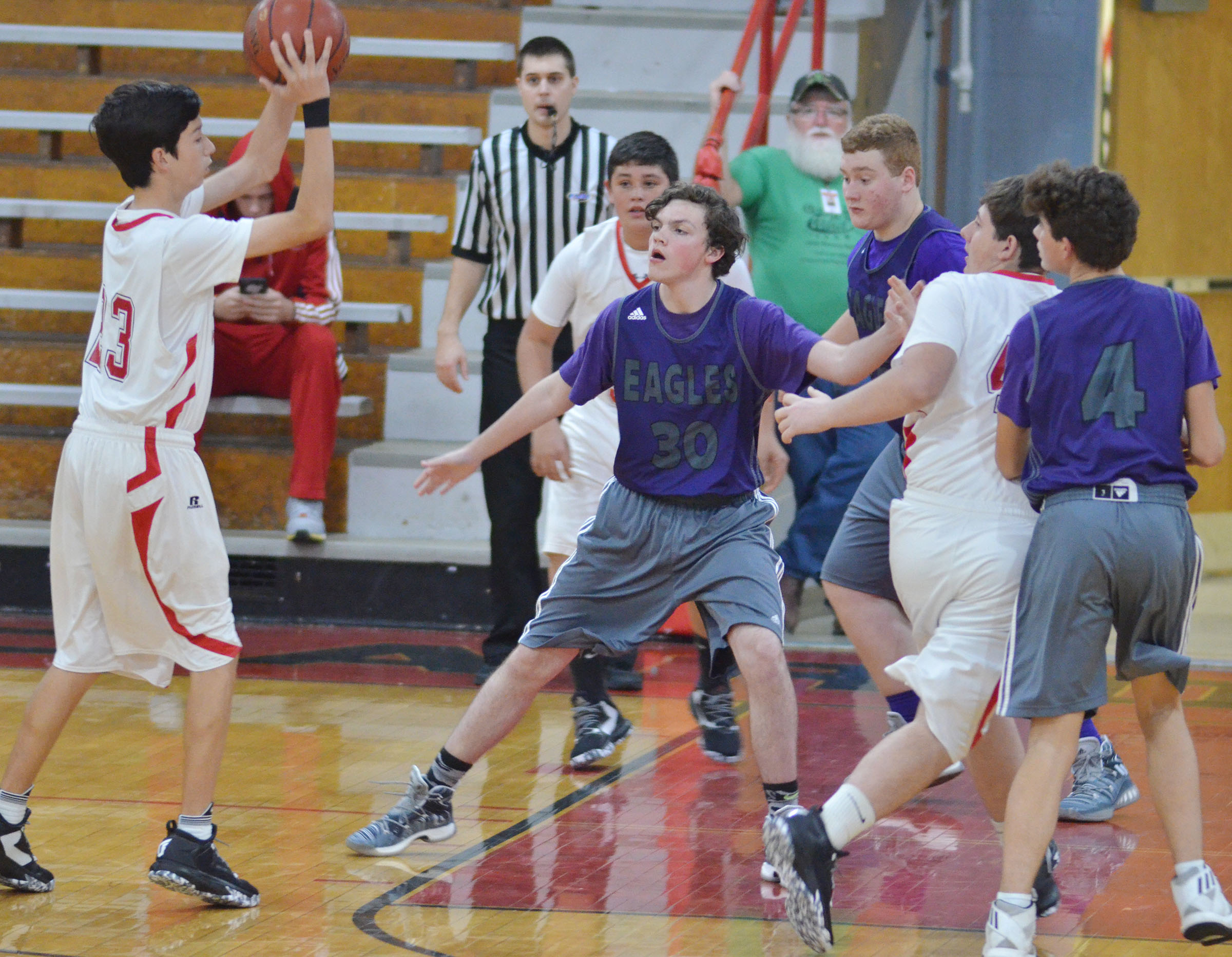 From left CHS freshman Jimmy Russell, sophomore Spencer Swafford and freshman Mark Rigsby play defense.