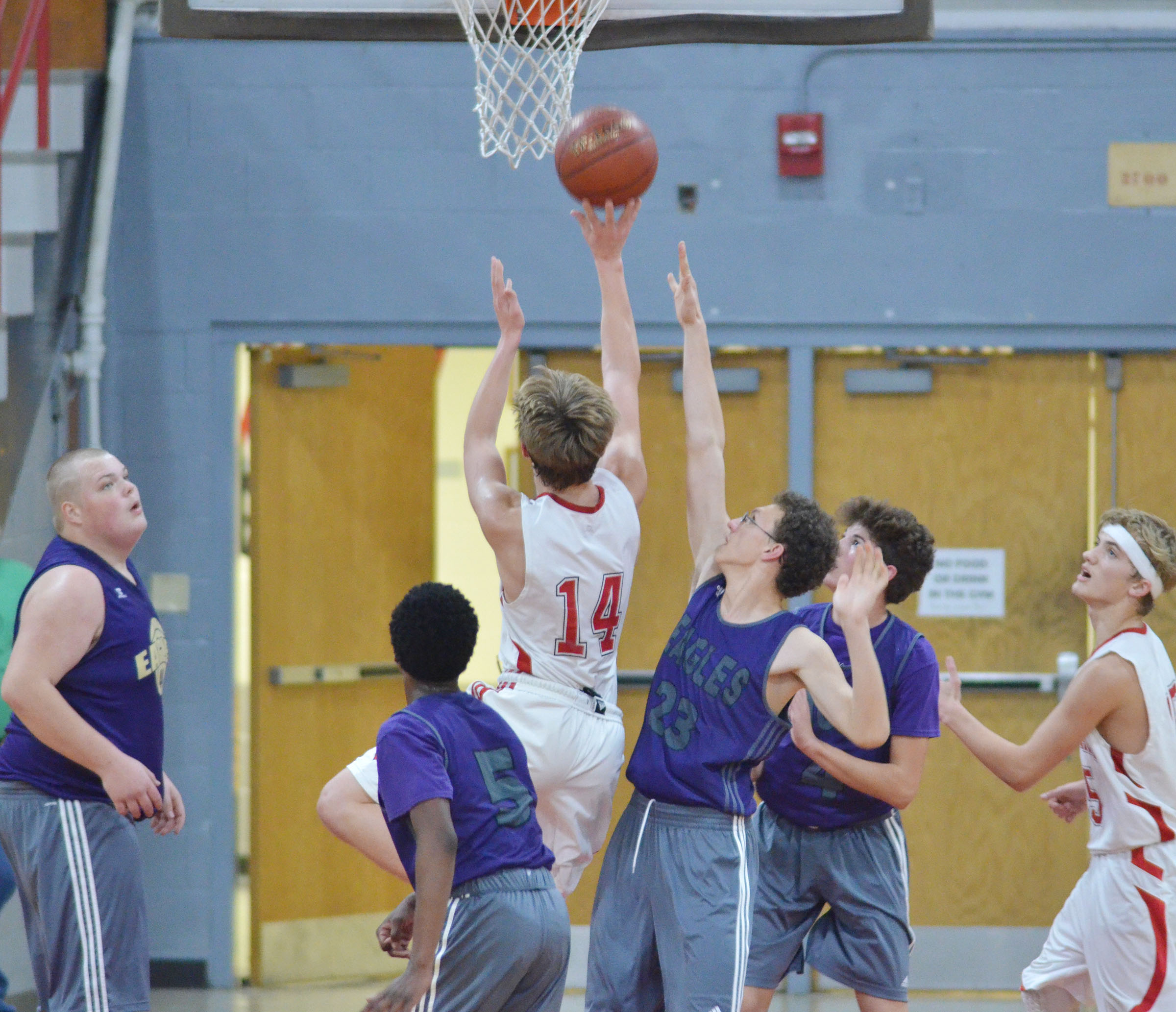 From left, CHS junior Toyse Cox and freshman Malachi Corley, Brennon Wheeler and Mark Rigsby try to block a shot.