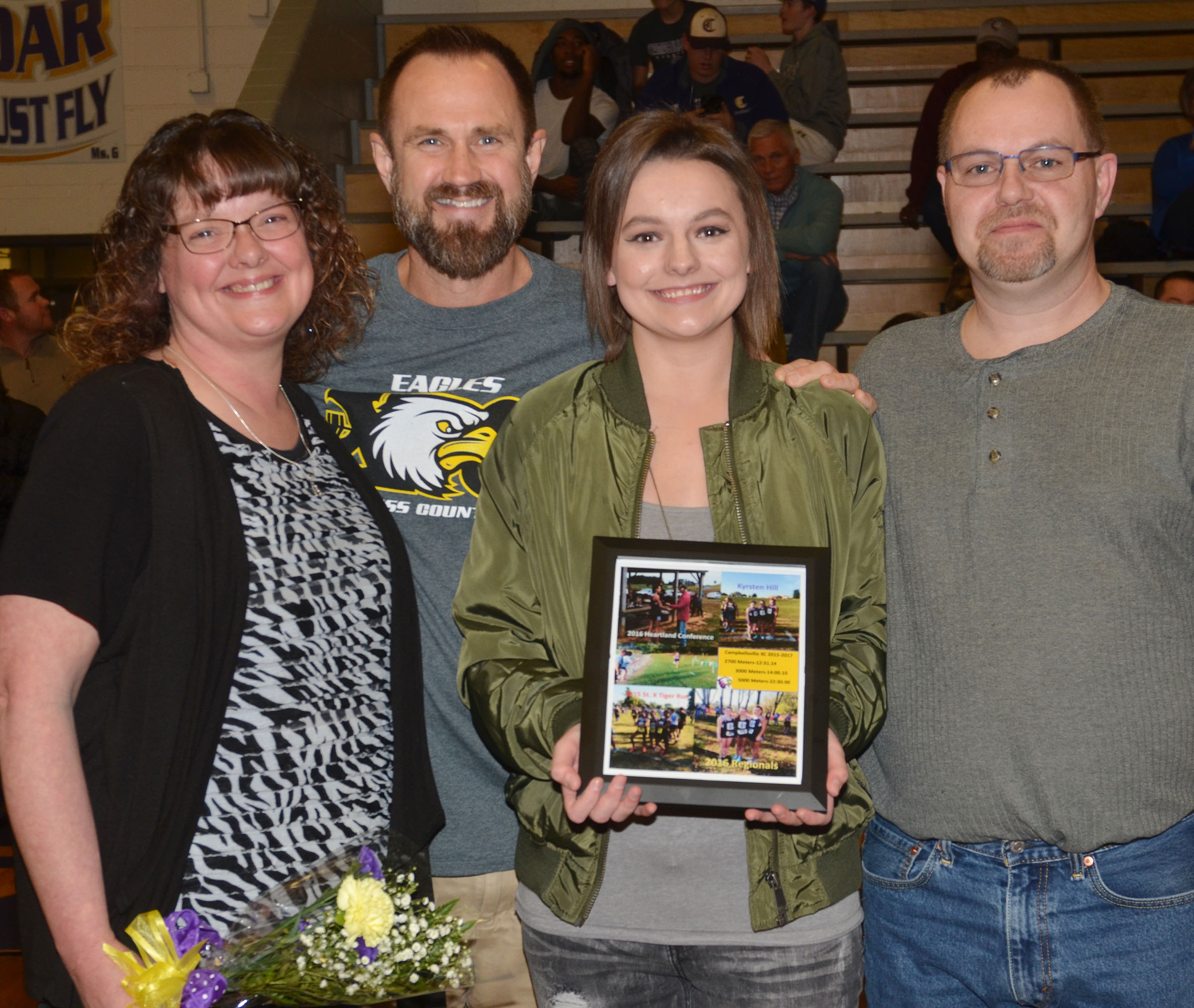 CHS senior cross country runner Kyrsten Hill is honored. From left are Hill's mother Tonya, CHS cross country coach Steve Doss, Kyrsten and Hill's father Jonathan.