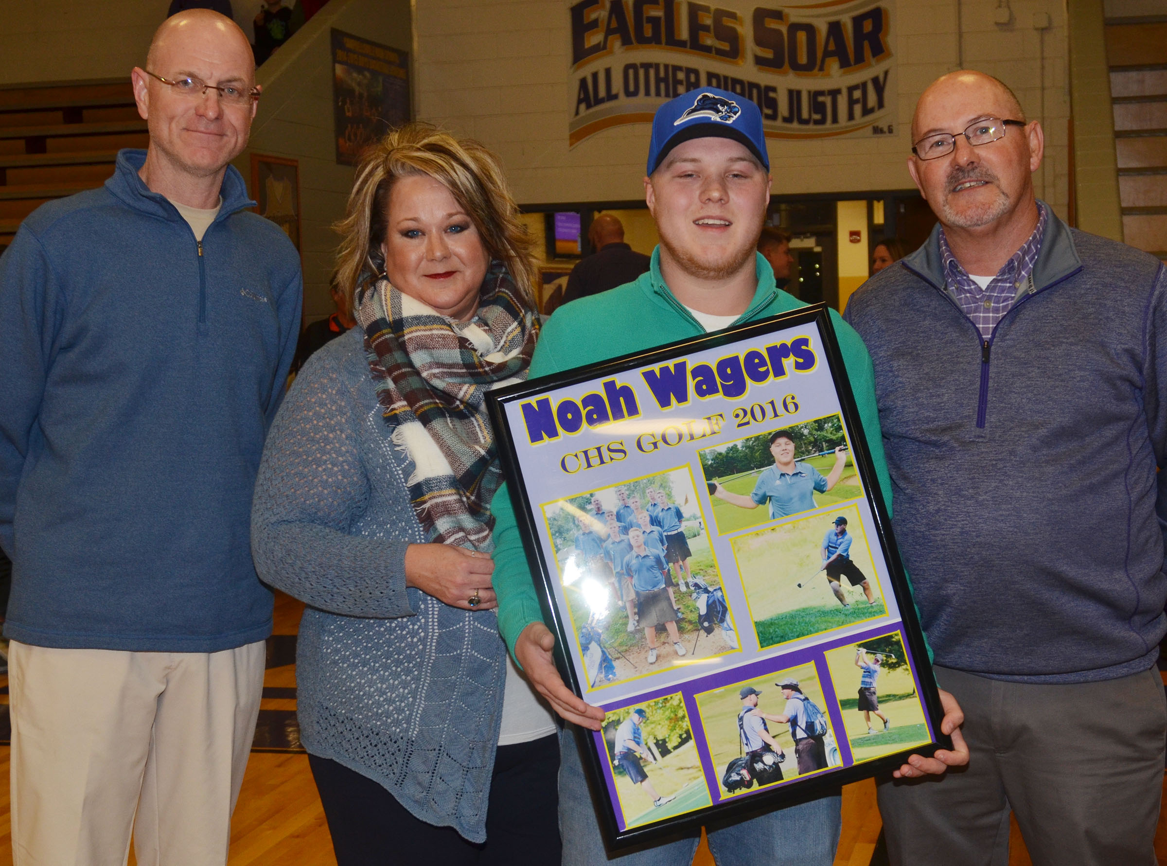 CHS senior golf player Noah Wagers is honored. From left are his parents Steve and Kim Wagers, Noah and CHS boys' golf coach Jim Ward.