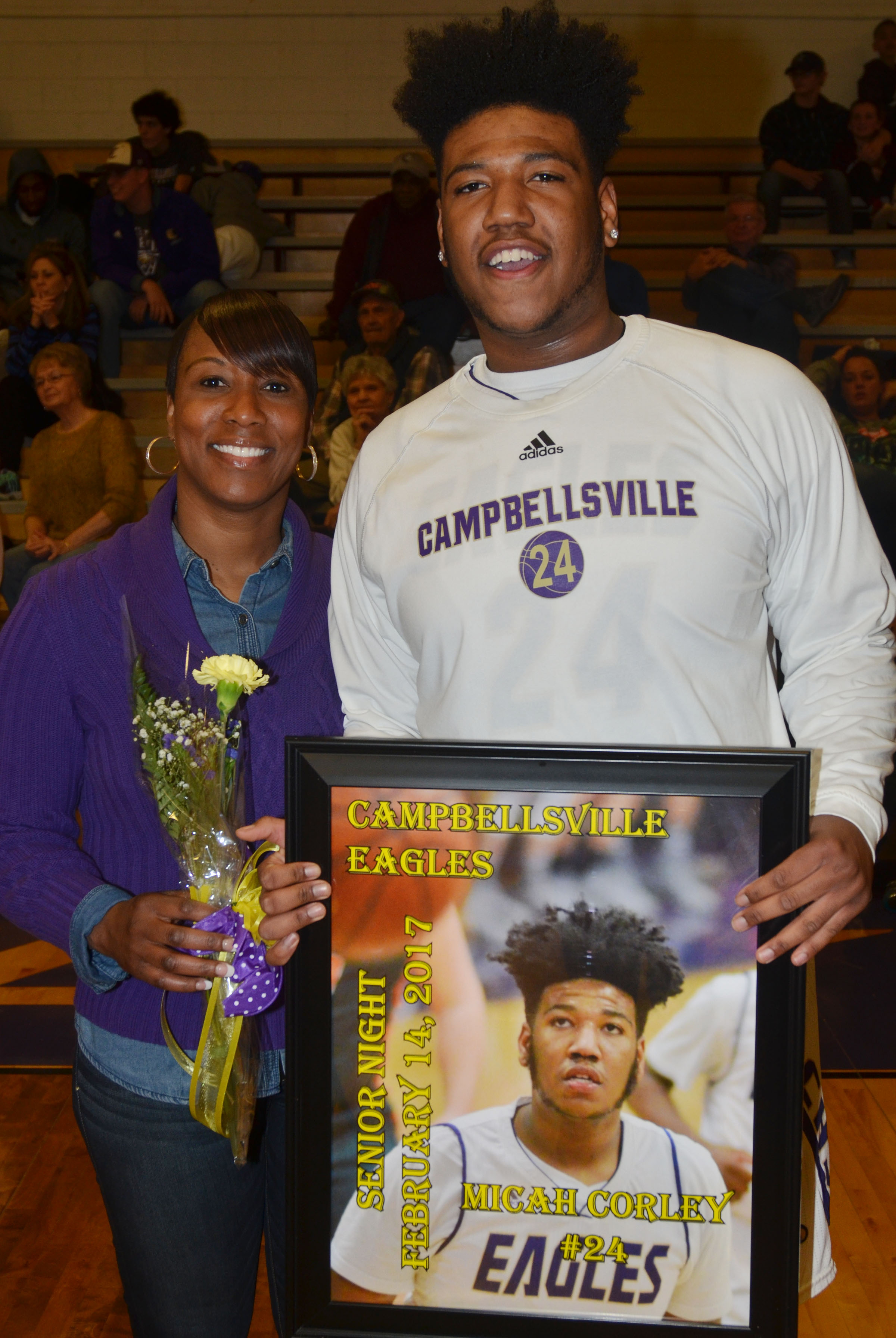 CHS senior boys' basketball player Micah Corley is honored. He is pictured with his mother, Latonya Bridgewater.