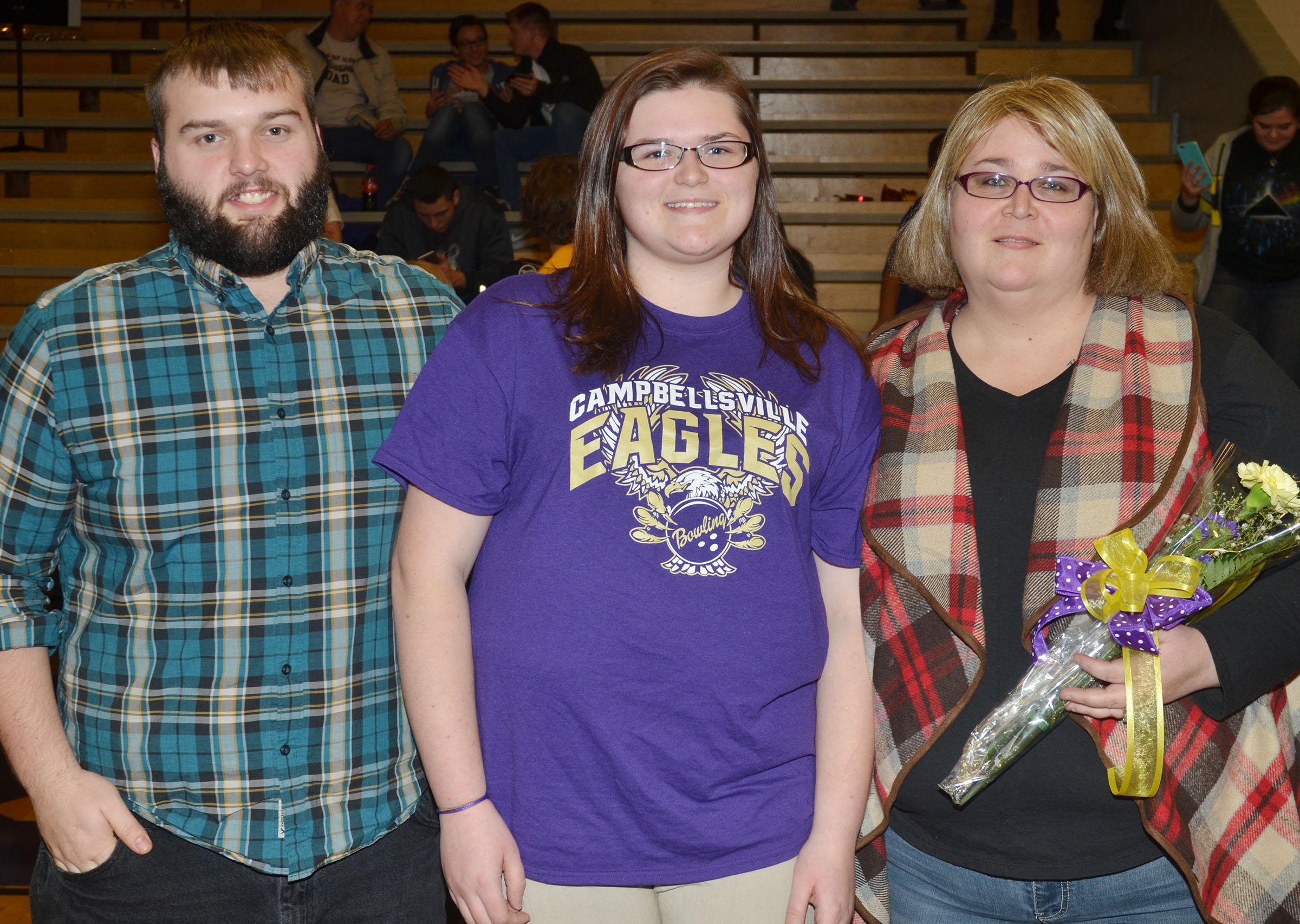 CHS senior bowling team member Vera Brown is honored. She is pictured with her mother Tonya Tate and stepfather Andrew Tate.