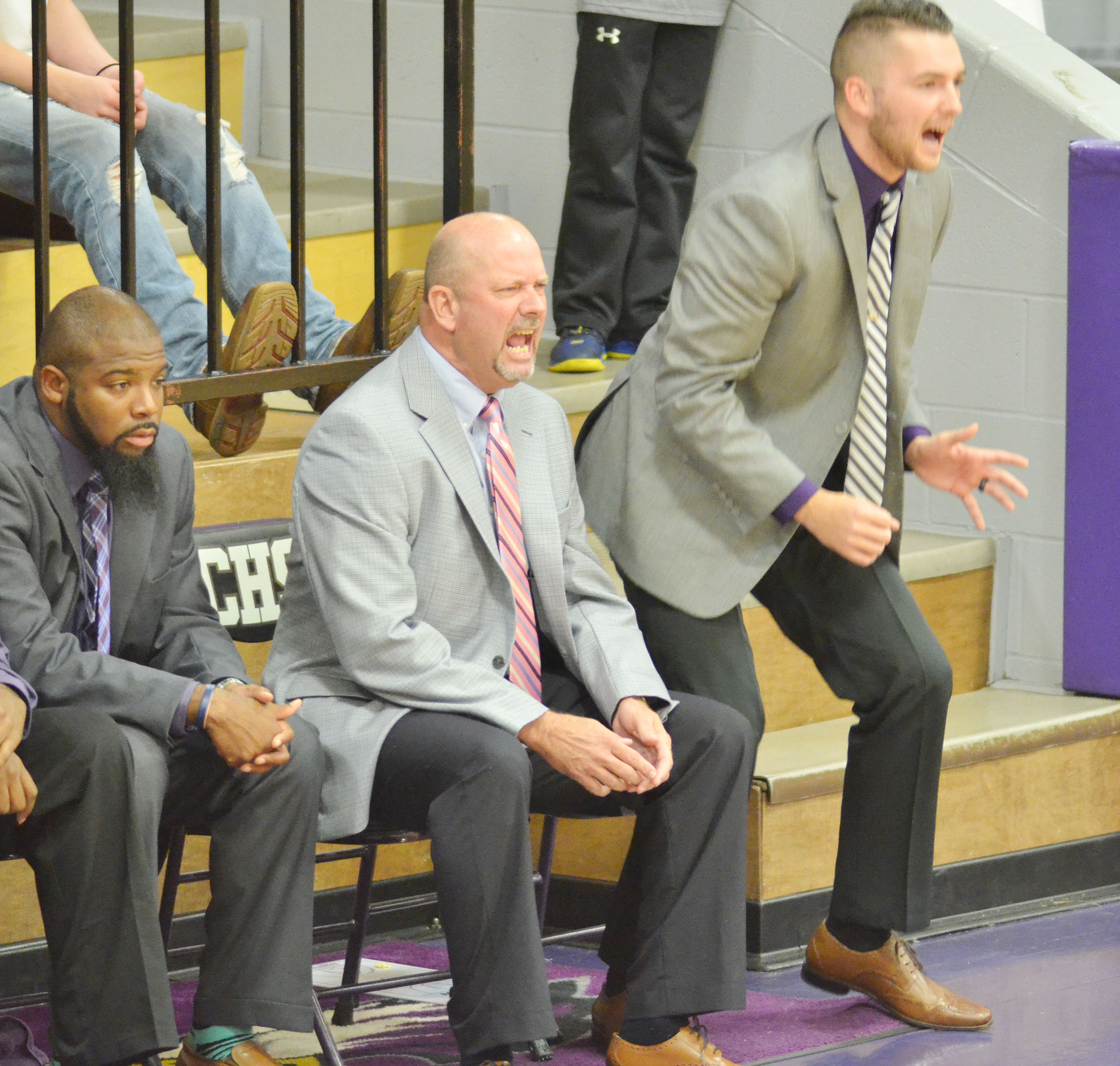 CHS basketball coaches, from left, assistant Will Griffin, head coach Tim Davis and assistant Cody Wills yell to their players.