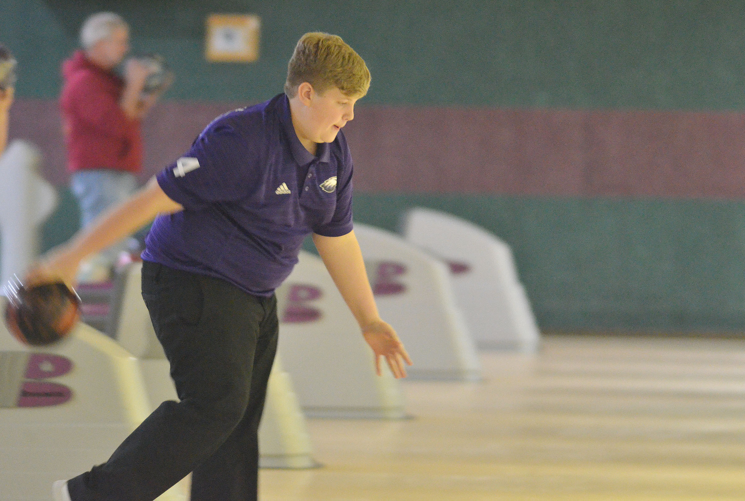 Campbellsville Middle School eighth-grader Noah Mardis bowls.