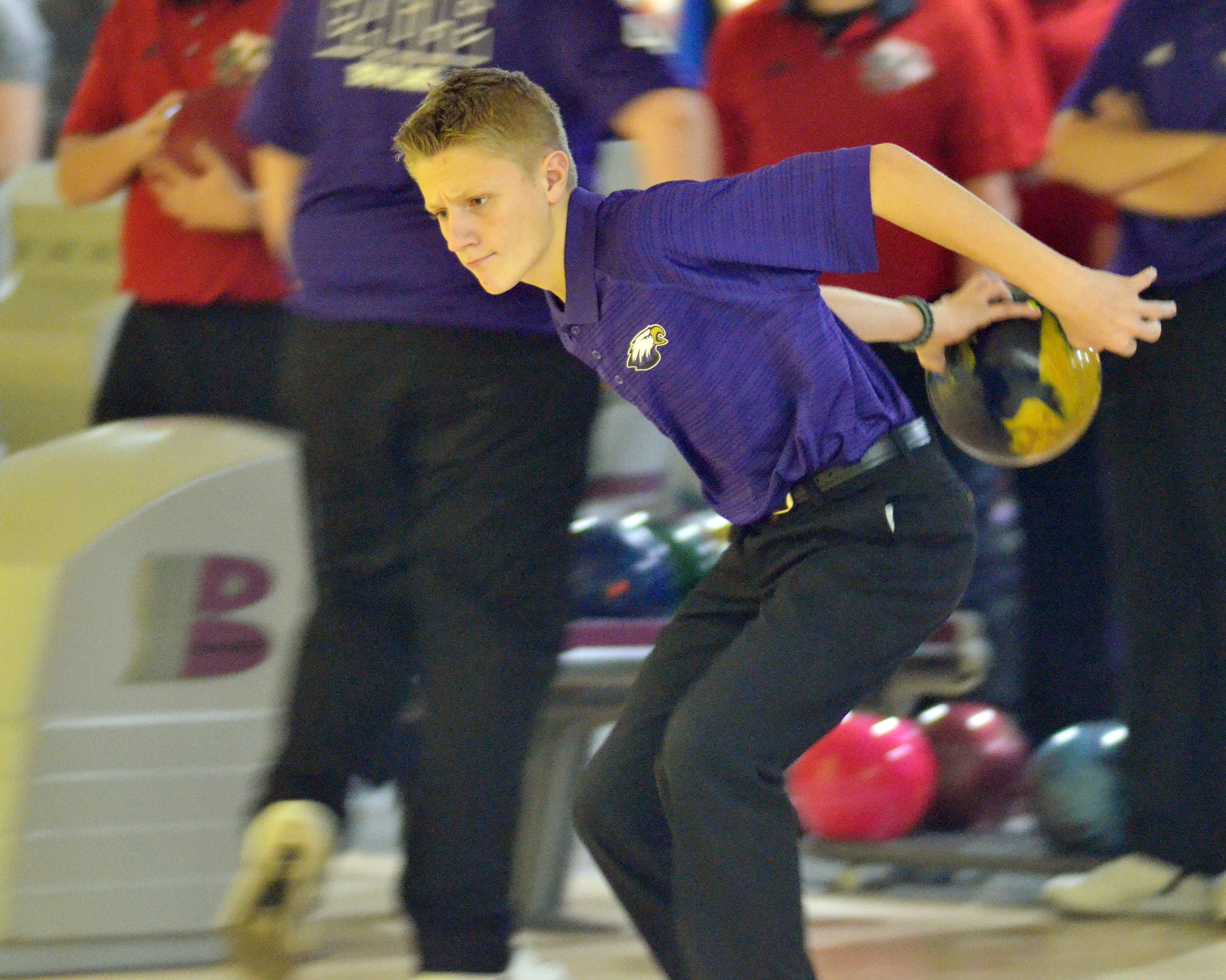 Campbellsville Middle School eighth-grader Jake Dicken bowls a strike.