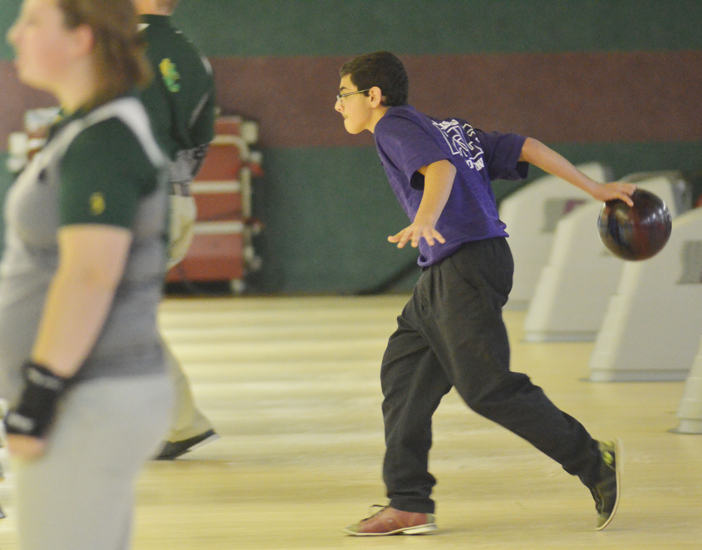 Campbellsville Middle School eighth-grader Hassan Alabusalim bowls.