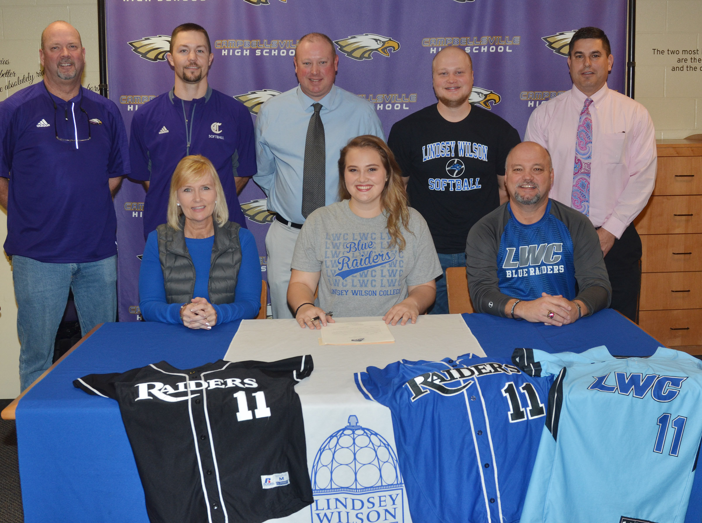 CHS senior Brenna Wethington has signed to continue her softball career at Lindsey Wilson College. She is pictured her parents, Sheila and John Wethington. From left, back, CHS Athletic Director Tim Davis, CHS head softball coach Weston Jones, LWC head softball coach David Dews, Wethington's brother Mason Wethington and CHS Principal Kirby Smith.