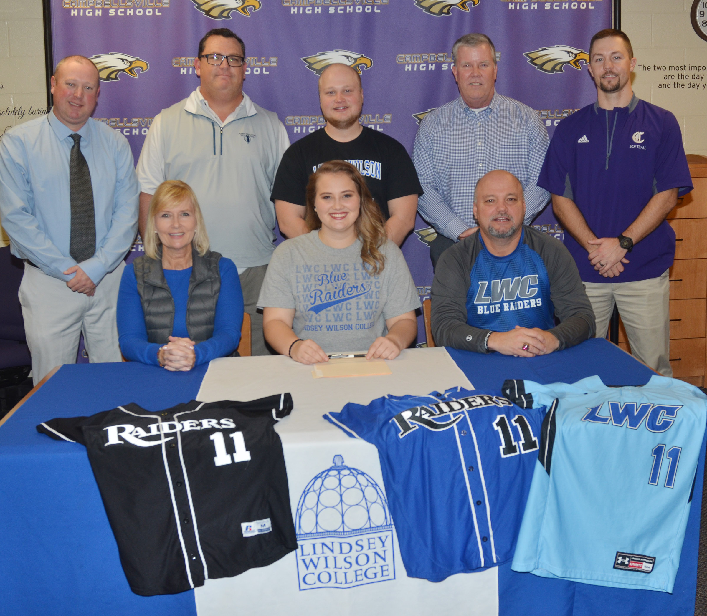 CHS senior Brenna Wethington has signed to continue her softball career at Lindsey Wilson College. She is pictured with her parents, Sheila and John Wethington. From left, back, LWC head softball coach David Dews, one of her first softball coaches Sarge Pollock, her brother Mason Wethington, another of her first softball coaches Jim Sabo and CHS head softball coach Weston Jones.