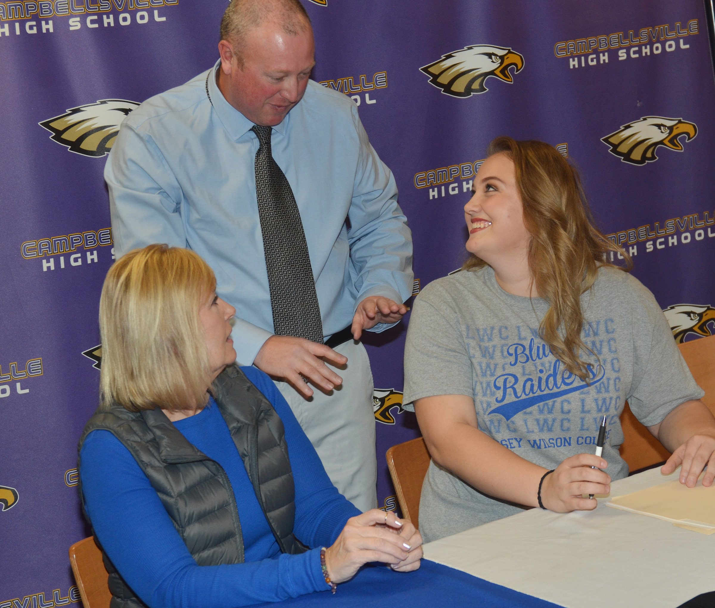 CHS senior Brenna Wethington has signed to continue her softball career at Lindsey Wilson College. She is pictured with her mother, Sheila Wethington, and her soon to be LWC softball coach David Dews.