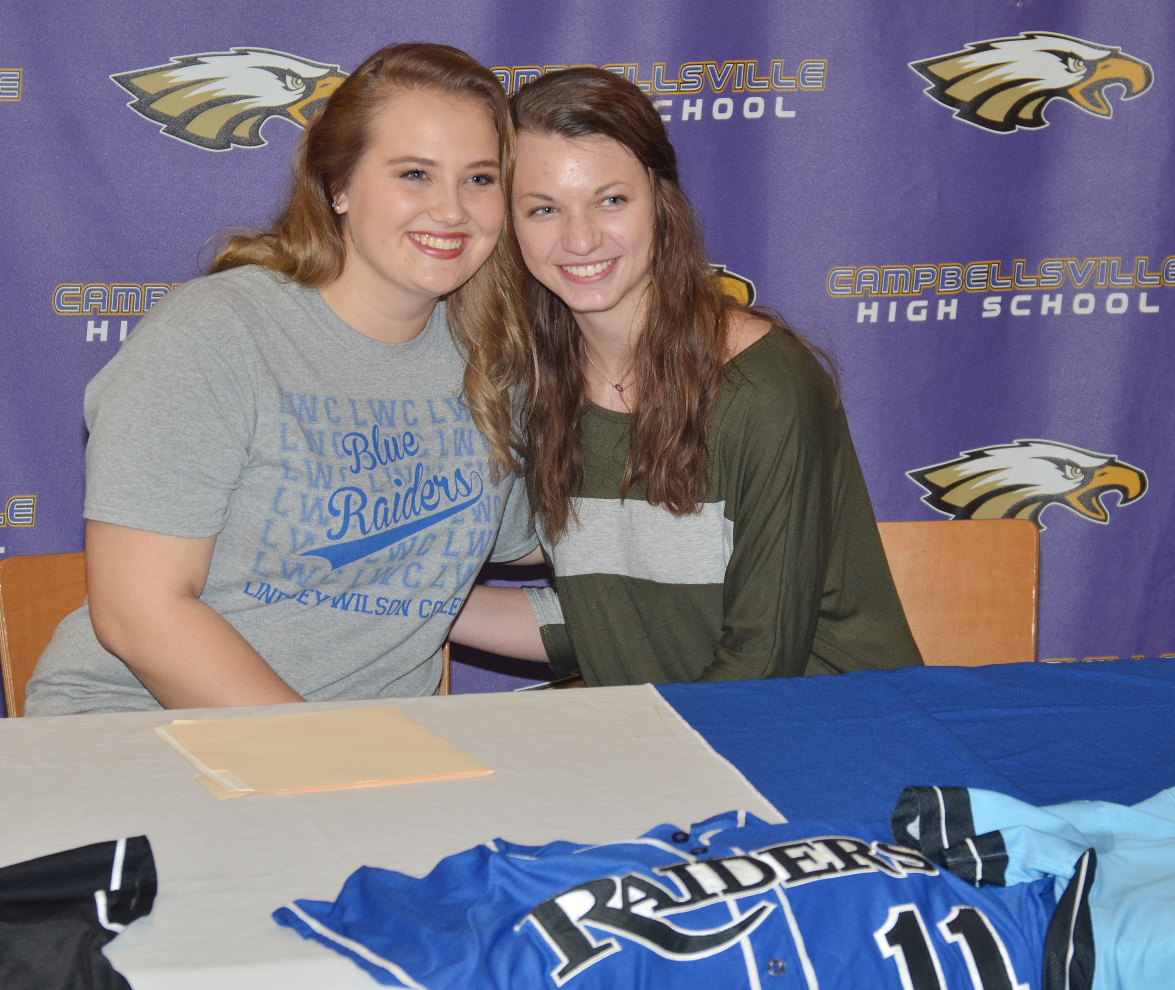 CHS senior Brenna Wethington has signed to continue her softball career at Lindsey Wilson College. She is pictured with her fellow CHS girls' basketball senior Caylie Blair.