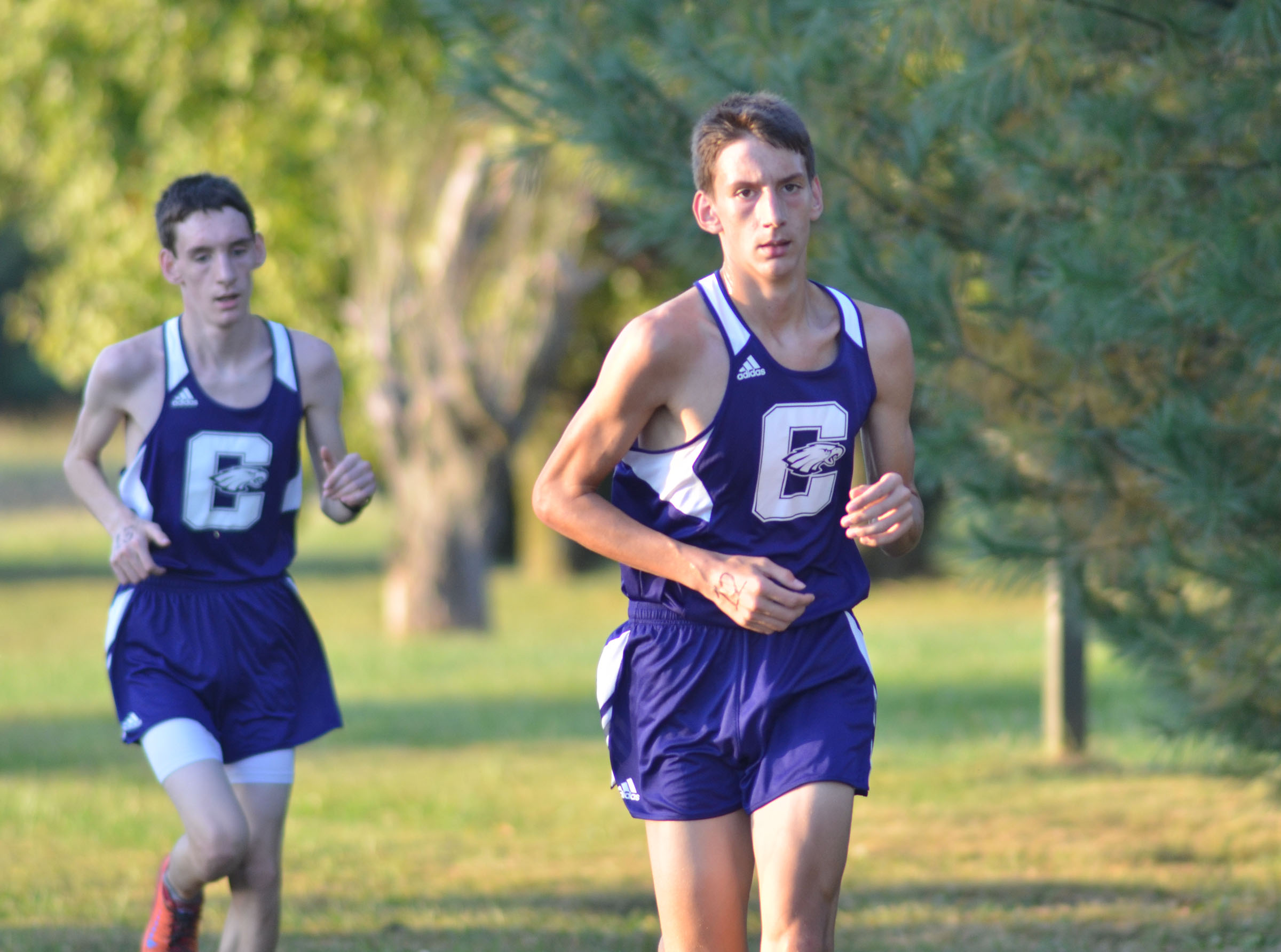 CHS sophomores Ian McAninch, left, and his two brother Evan McAninch run.