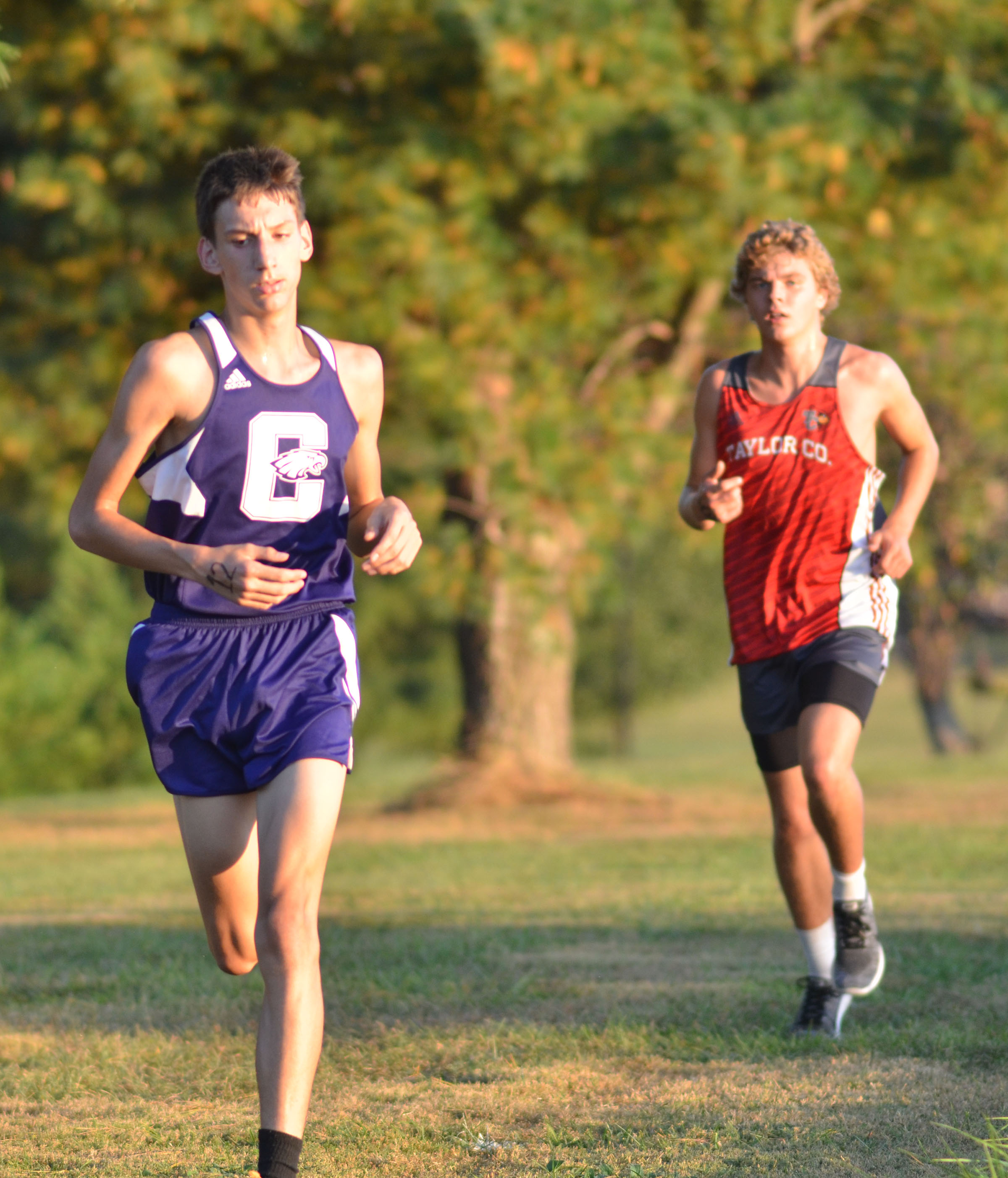 CHS sophomore Evan McAninch runs ahead of a Taylor County runner.