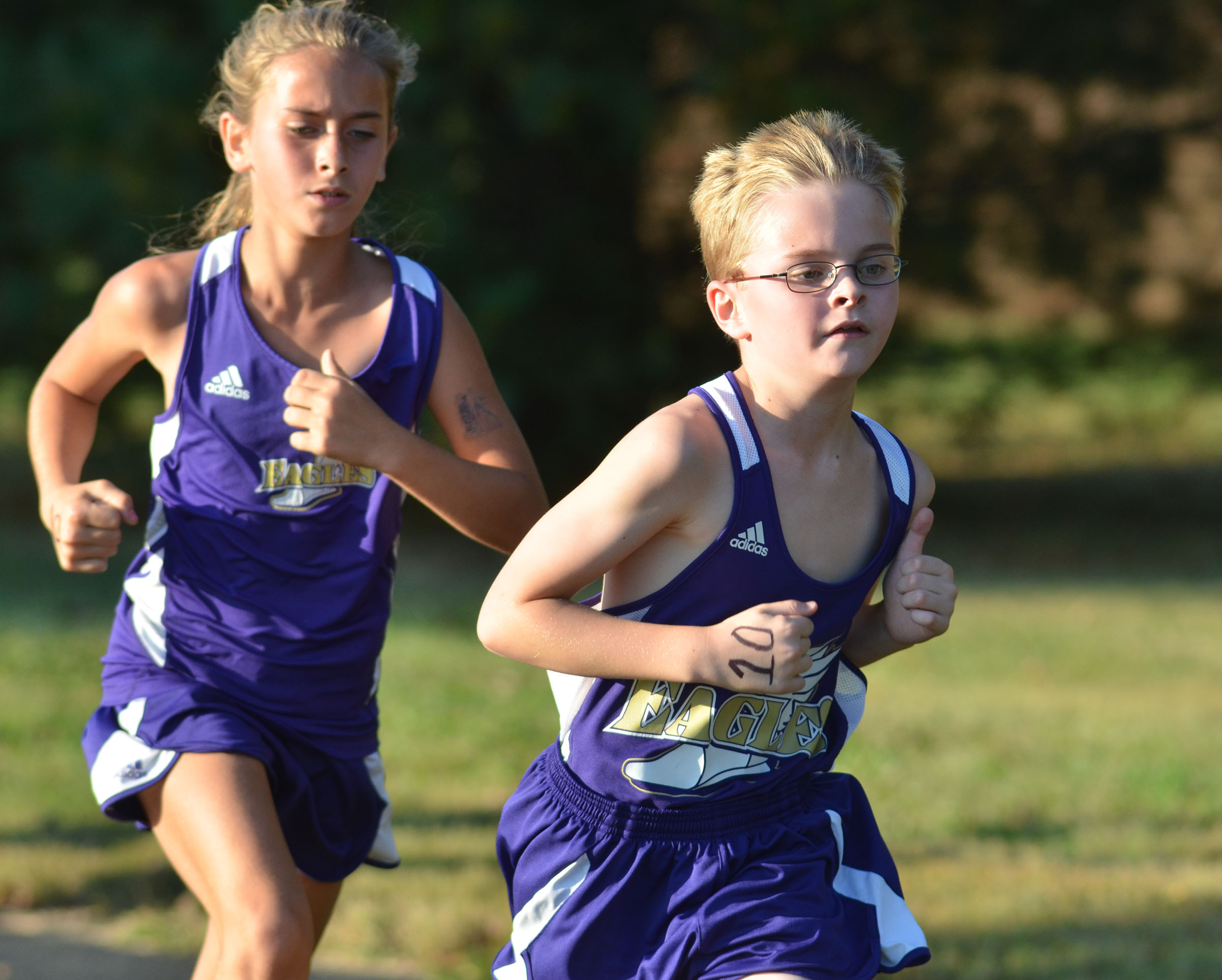 CMS fifth-grader Caleb Holt gains a slight lead on classmate Karleigh Oliver.