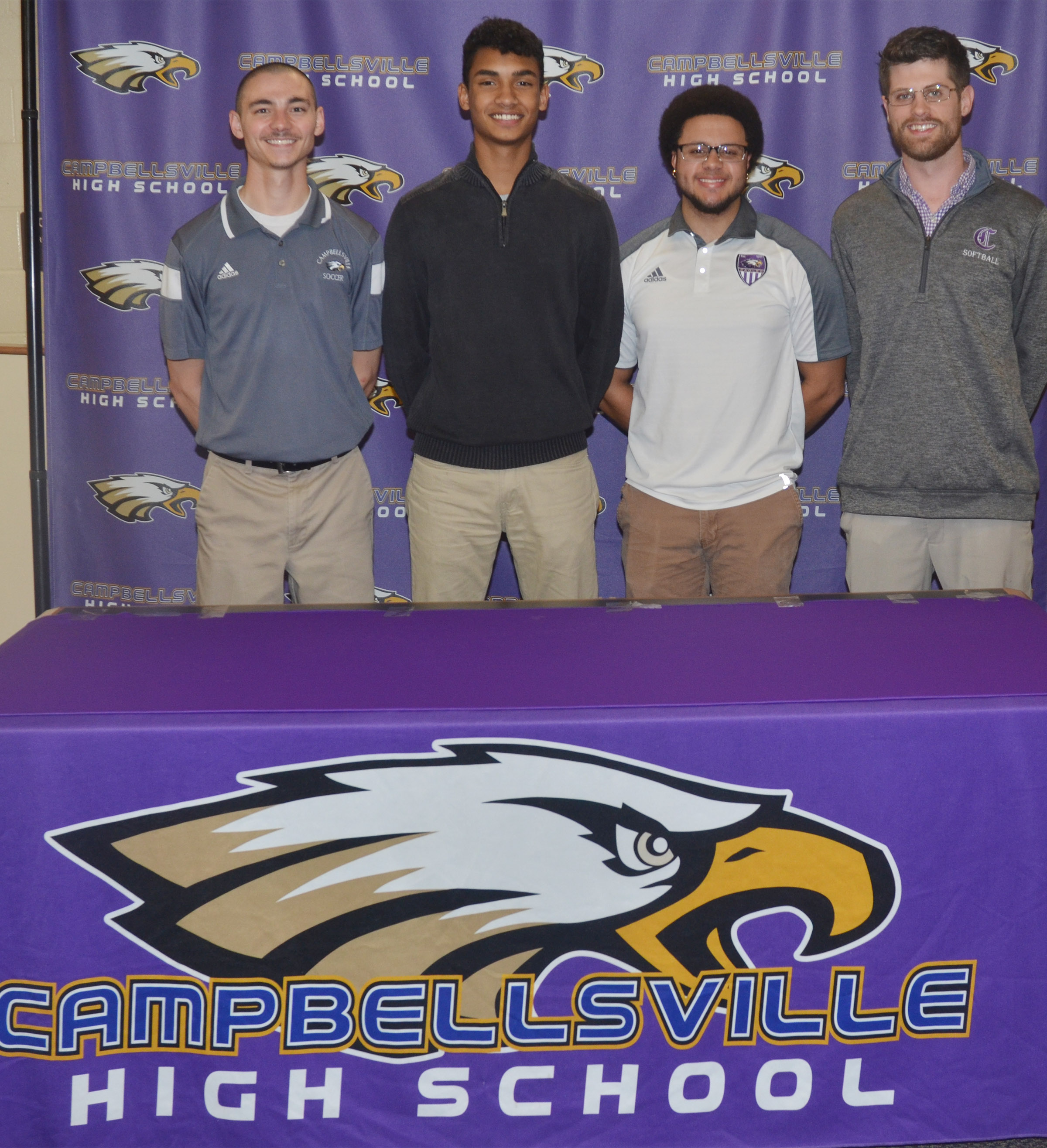 Campbellsville High School soccer player Daniel Silva will continue his academic and athletic career at Campbellsville University. Silva recently signed his letter of intent in a special ceremony with friends, family members, classmates and teammates. From left are CHS head soccer coach Bradley Harris, Silva and assistant coaches Malique Spaulding and Matt Schmuck.
