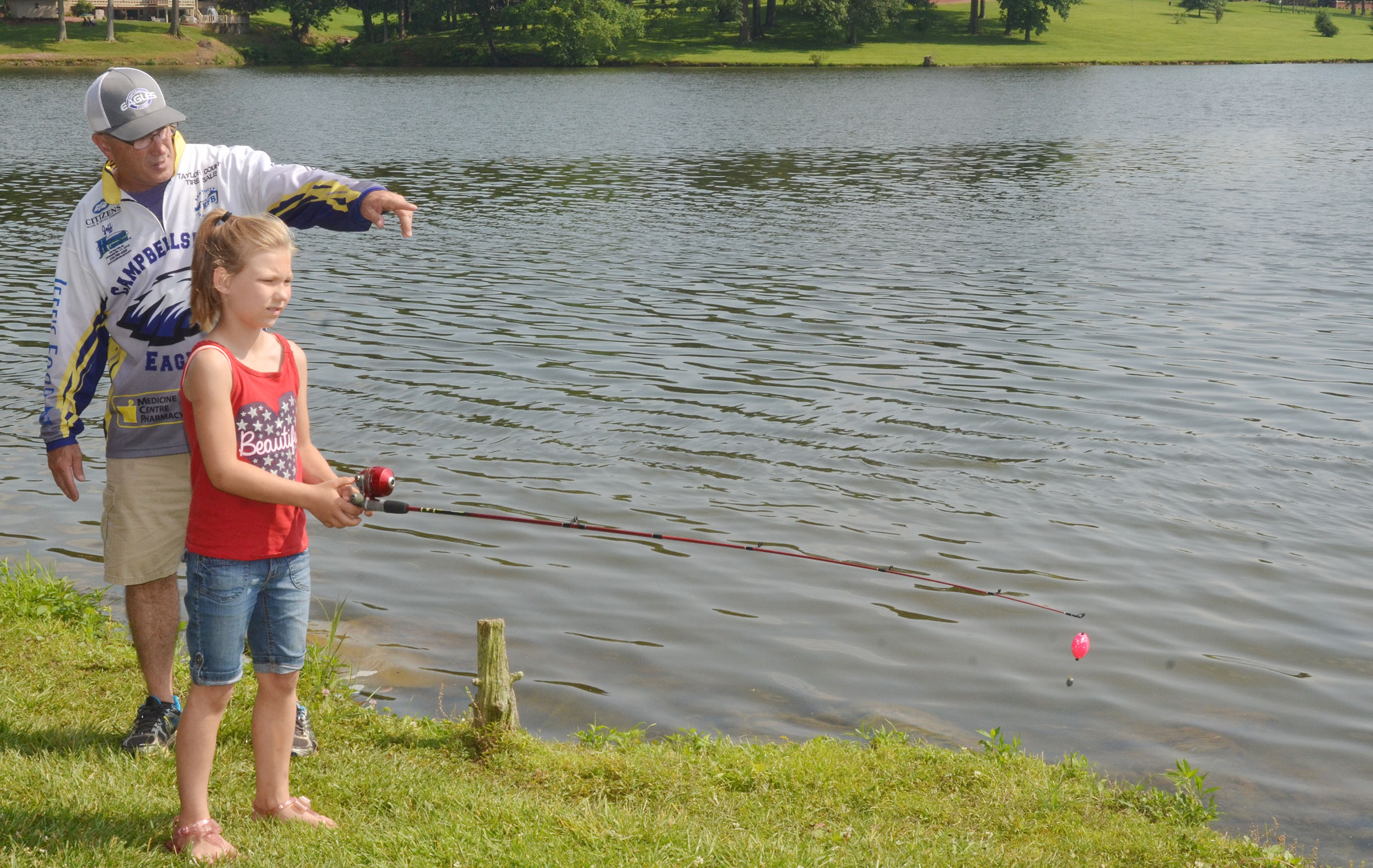 CHS fishing coach Jeff Richardson teaches Juleighana Swierczek to cast.