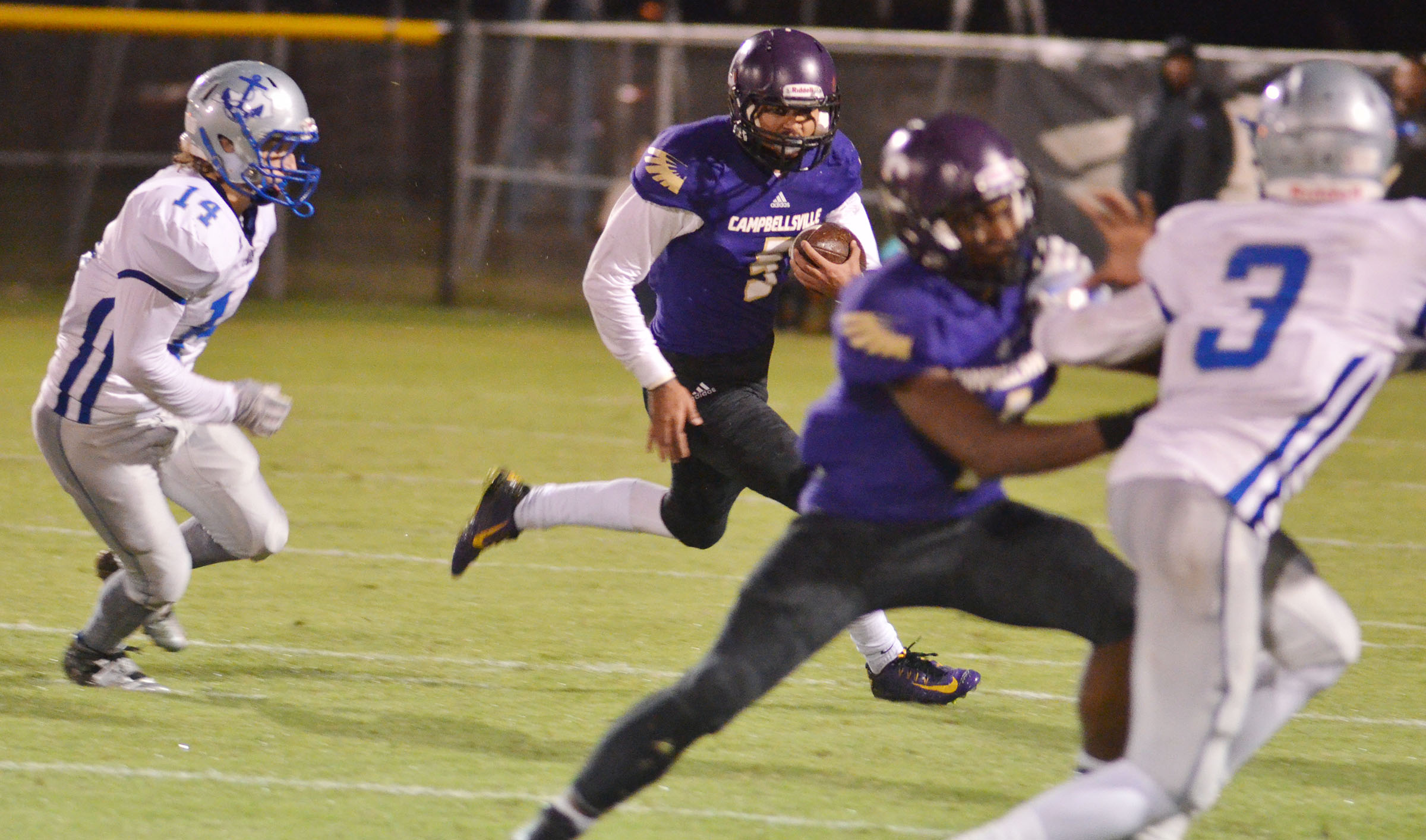 CHS senior Arick Groves runs the ball as his teammates block for him.