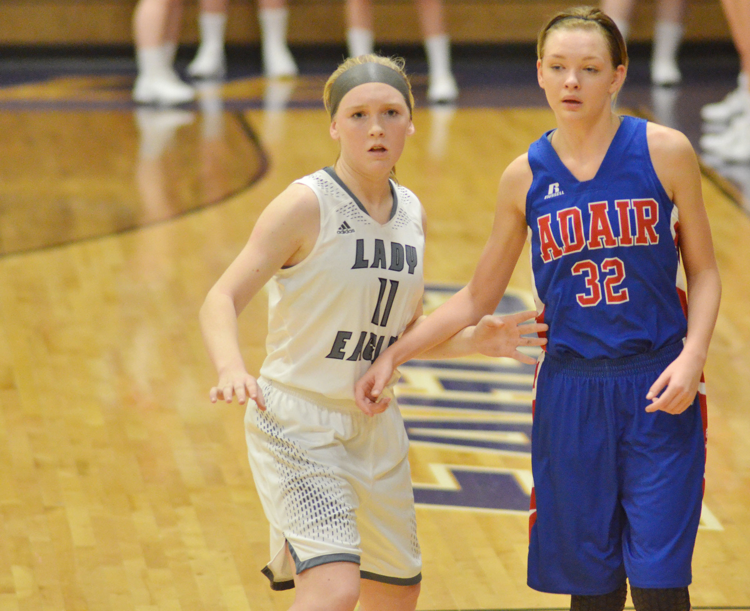 Campbellsville Middle School eighth-grader Catlyn Clausen guards an Adair County defender.