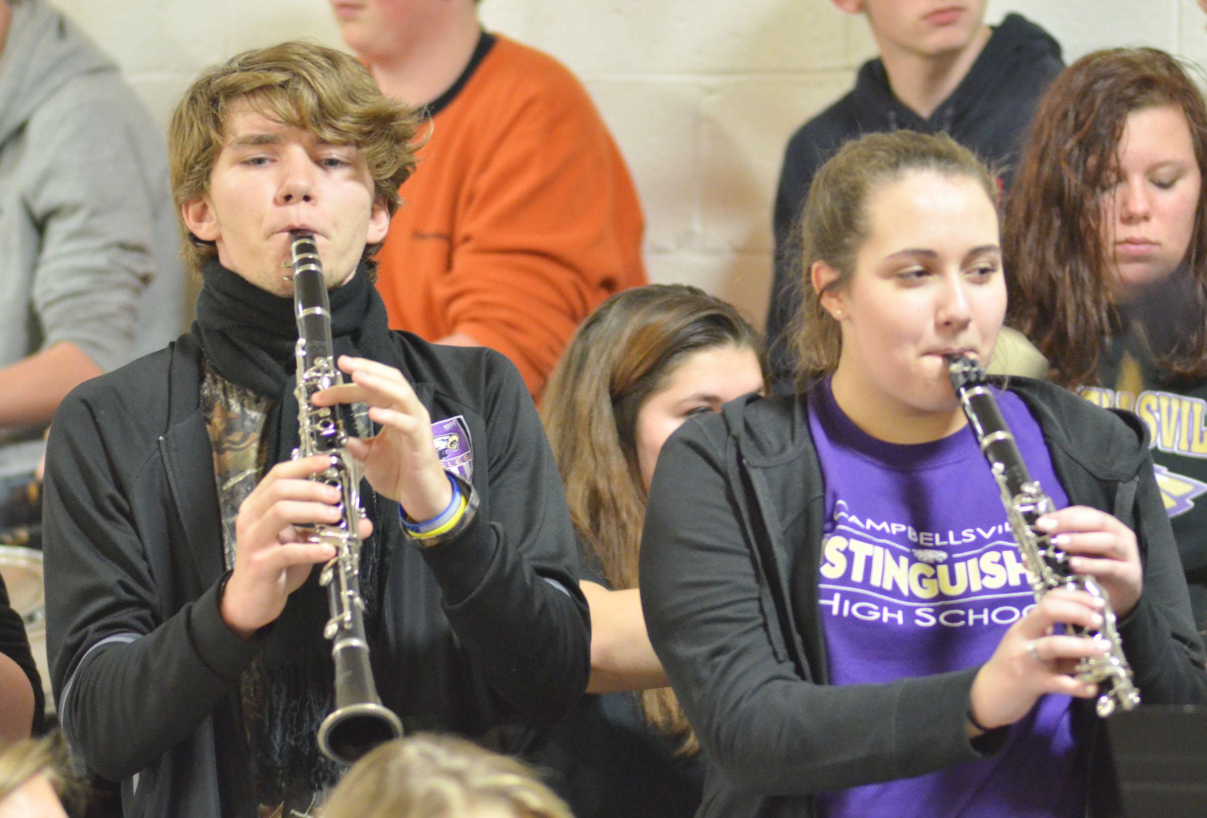 CHS junior Christian Berry, at left, and sophomore Elizabeth Sullivan play clarinet with the CHS Pep Band.