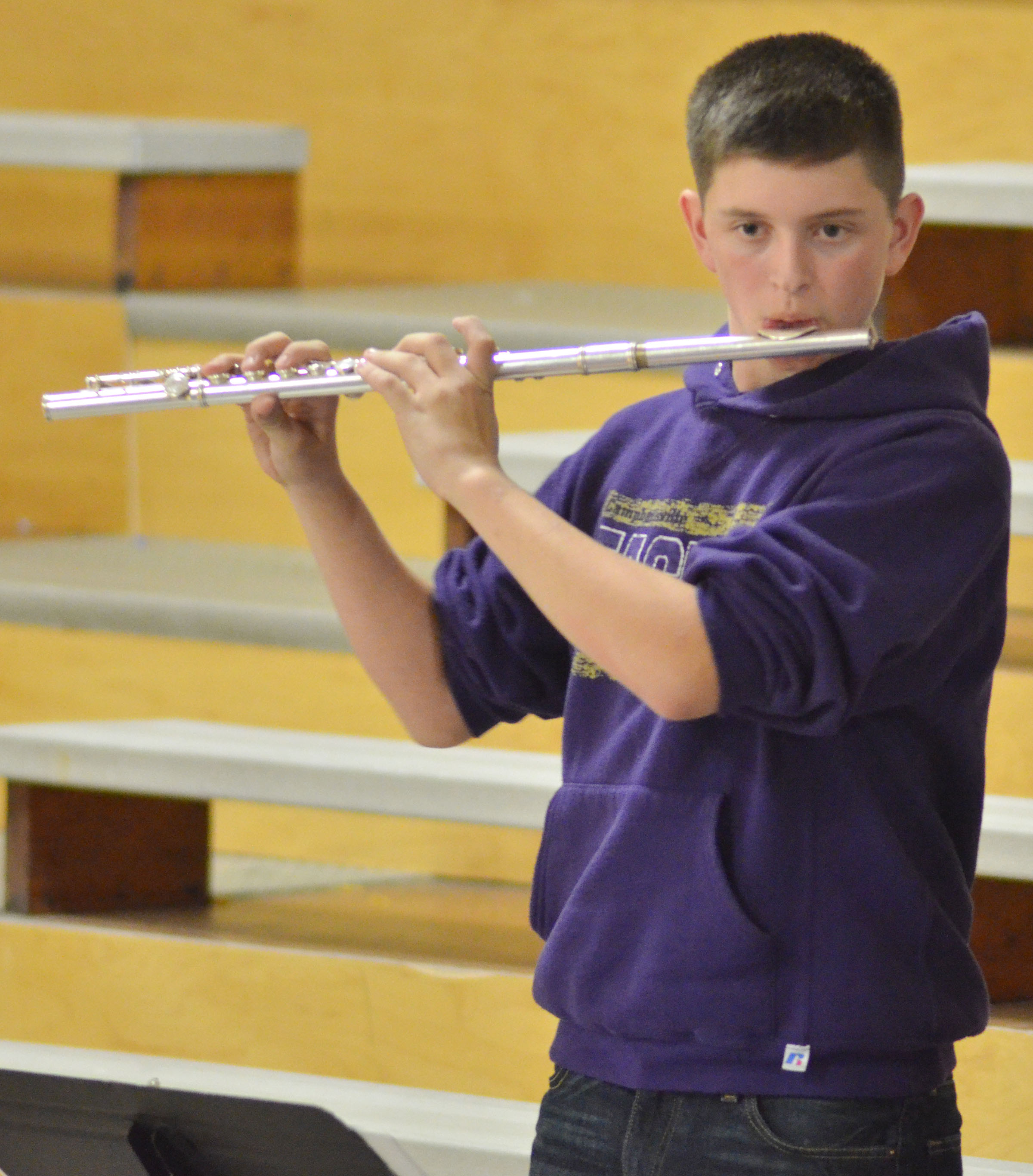 Campbellsville Middle School seventh-grader Caden Cowherd plays flute with the CHS Pep Band.