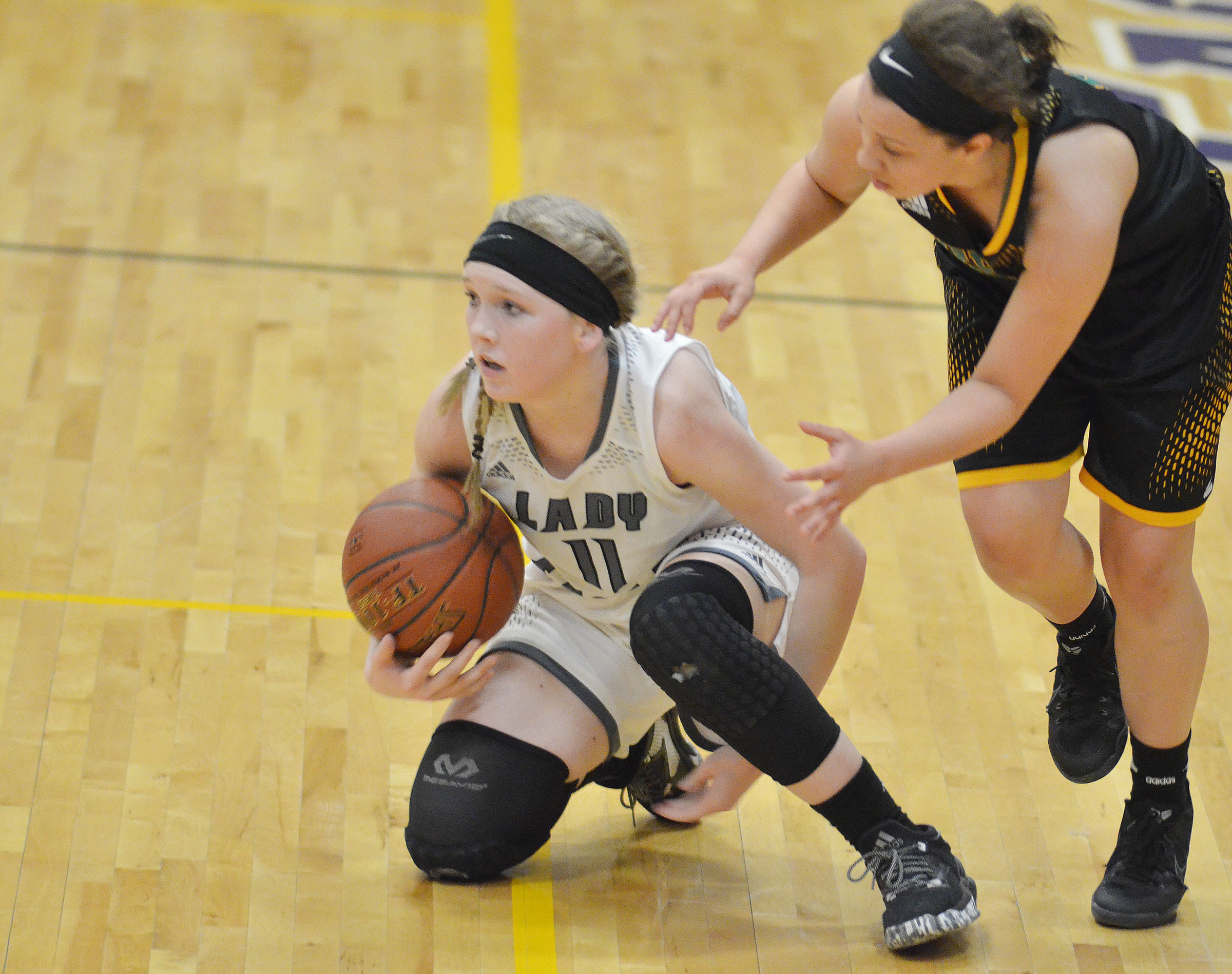 Campbellsville Middle School eighth-grader Catlyn Clausen protects the ball.