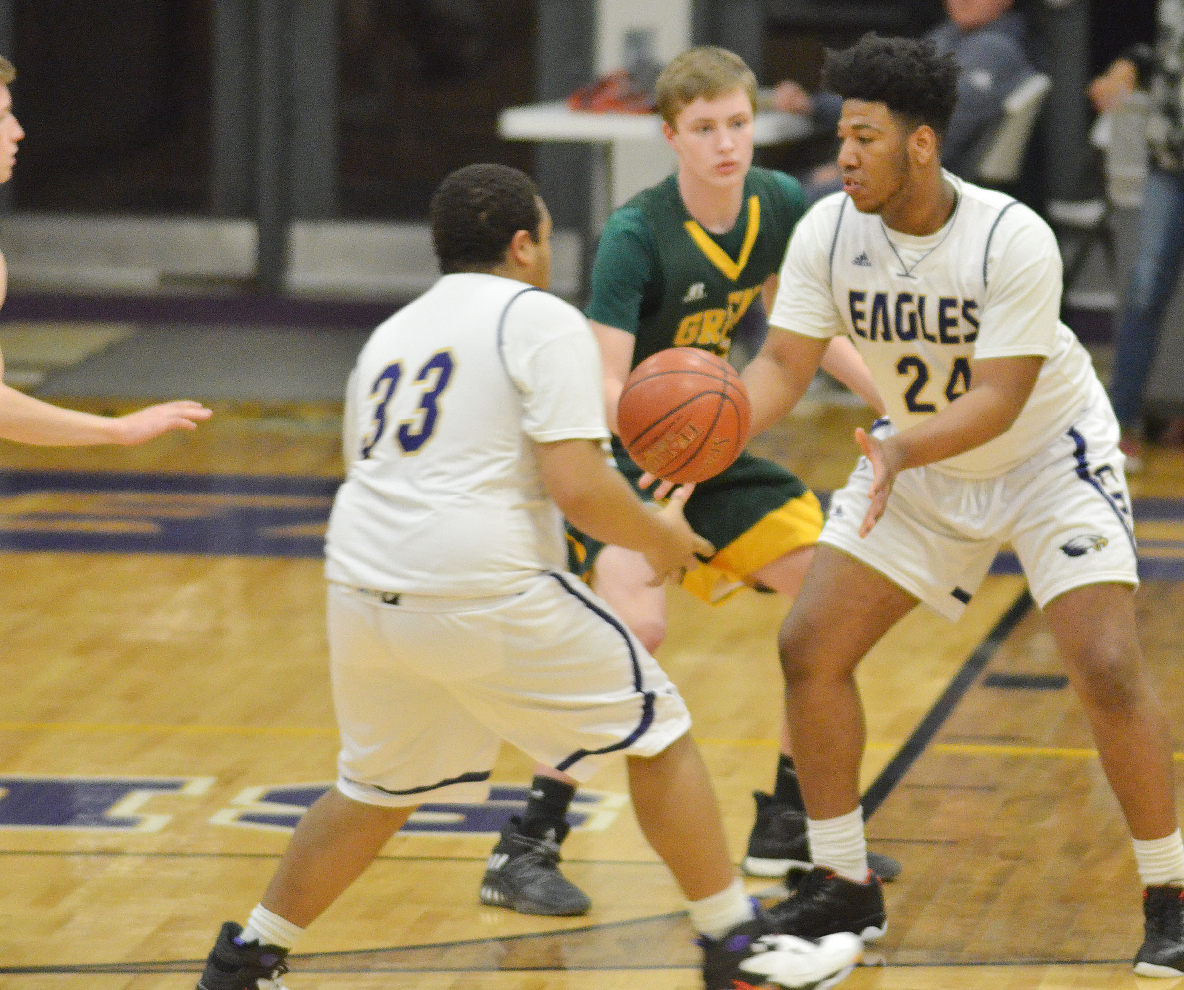 CHS senior Ricky Smith-Cecil passes the ball to fellow senior Micah Corley.