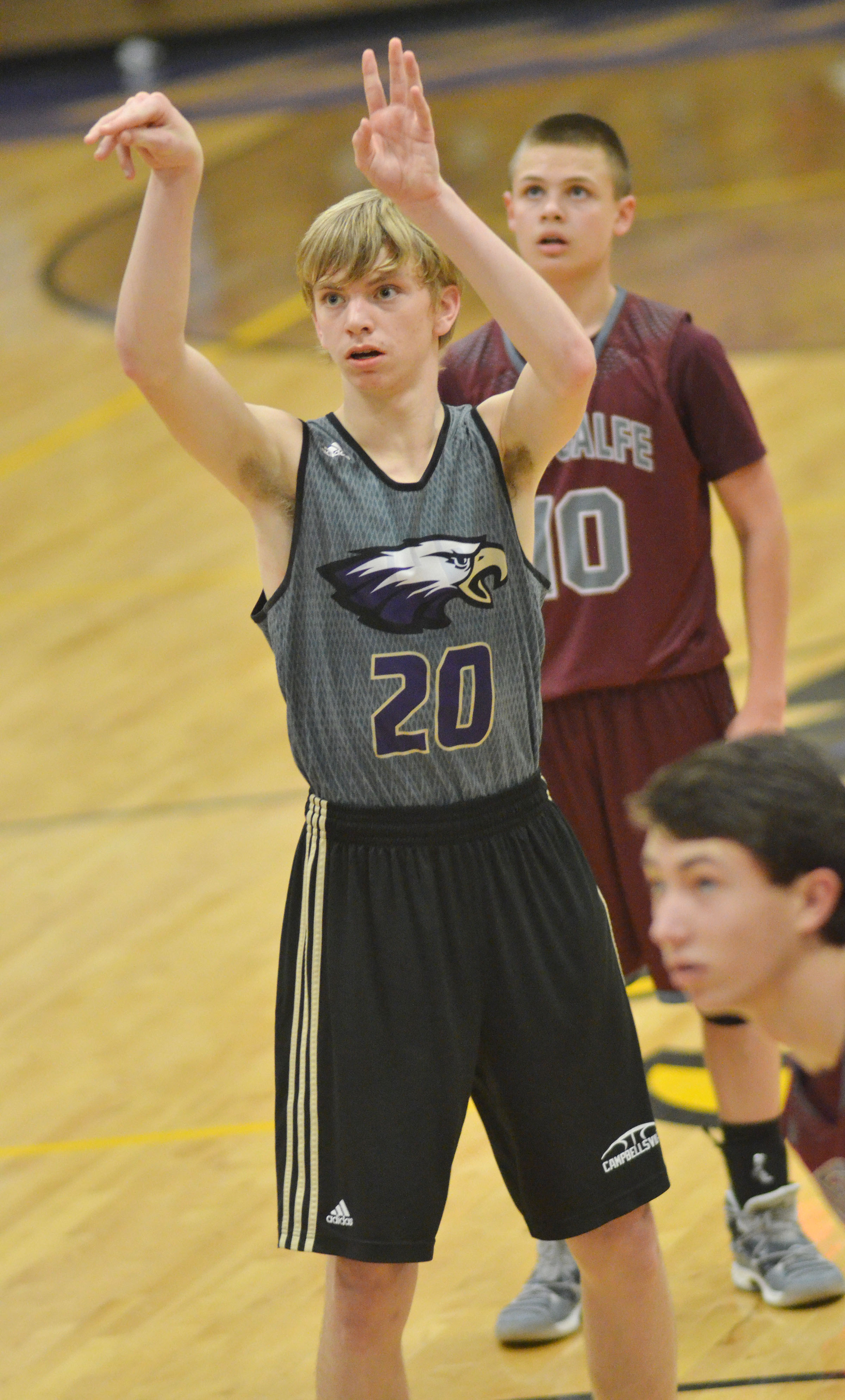 Campbellsville Middle School eighth-grader Arren Hash shoots the ball.