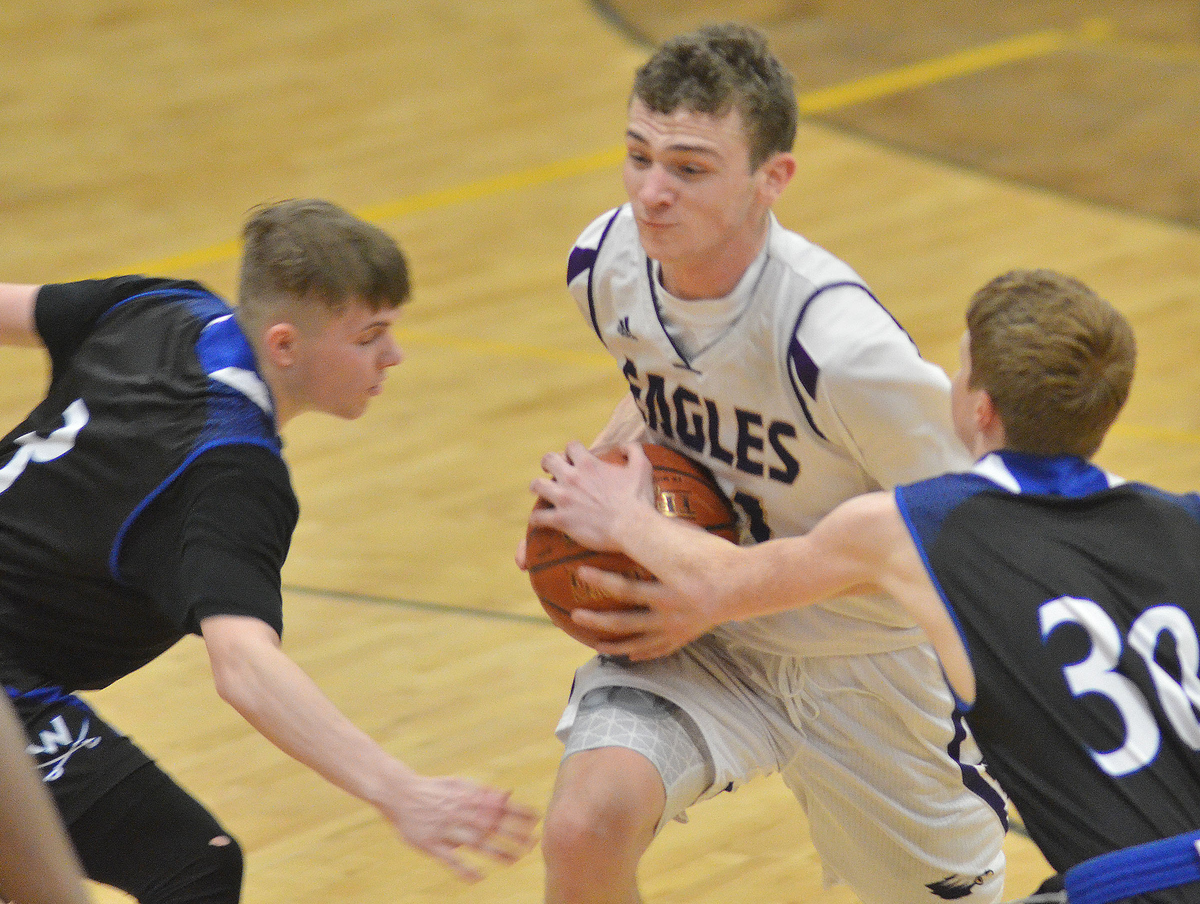 CHS junior Connor Wilson drives the ball to the hoop.
