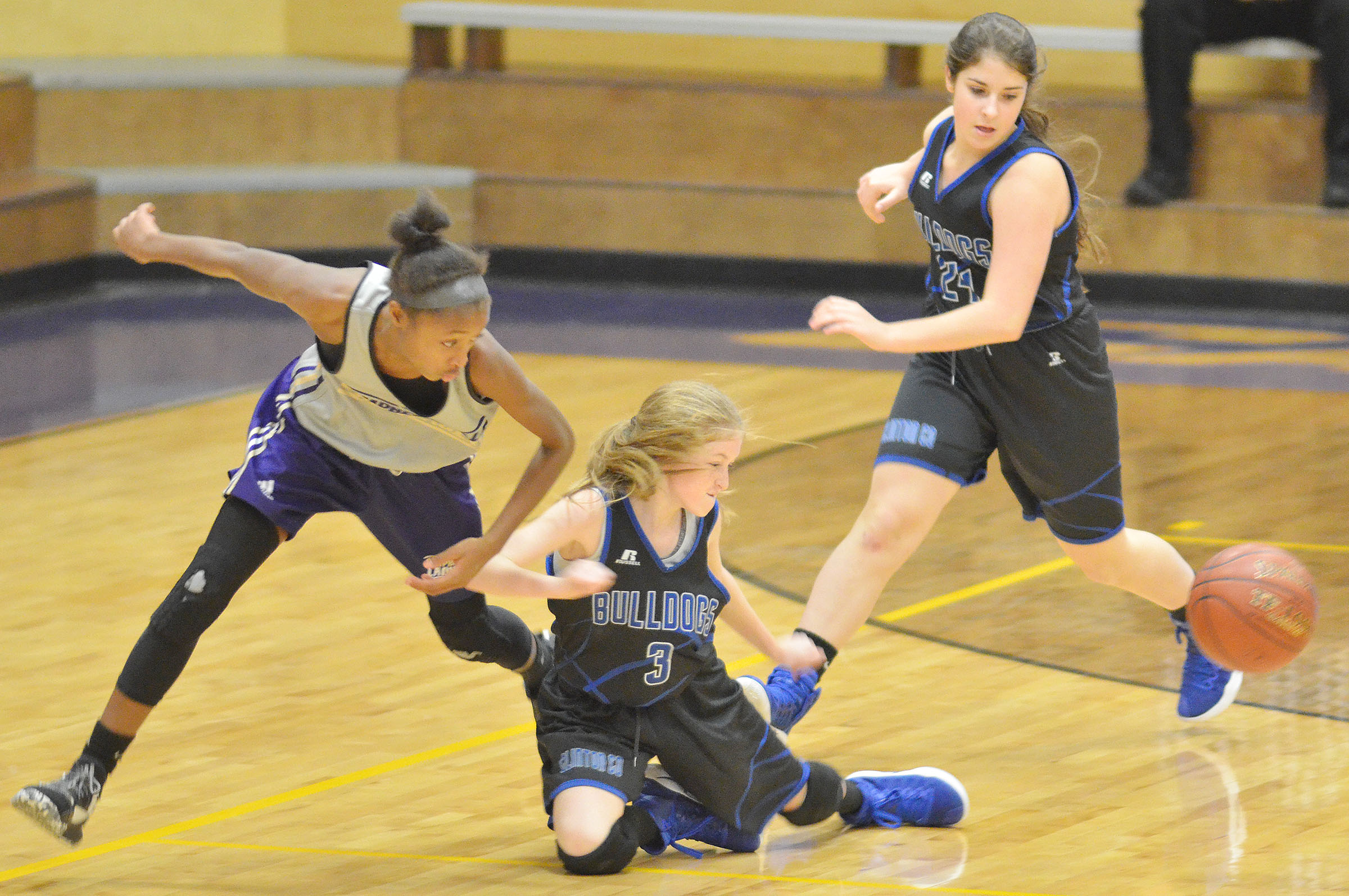 Campbellsville Middle School seventh-grader Bri Gowdy fights for the ball.