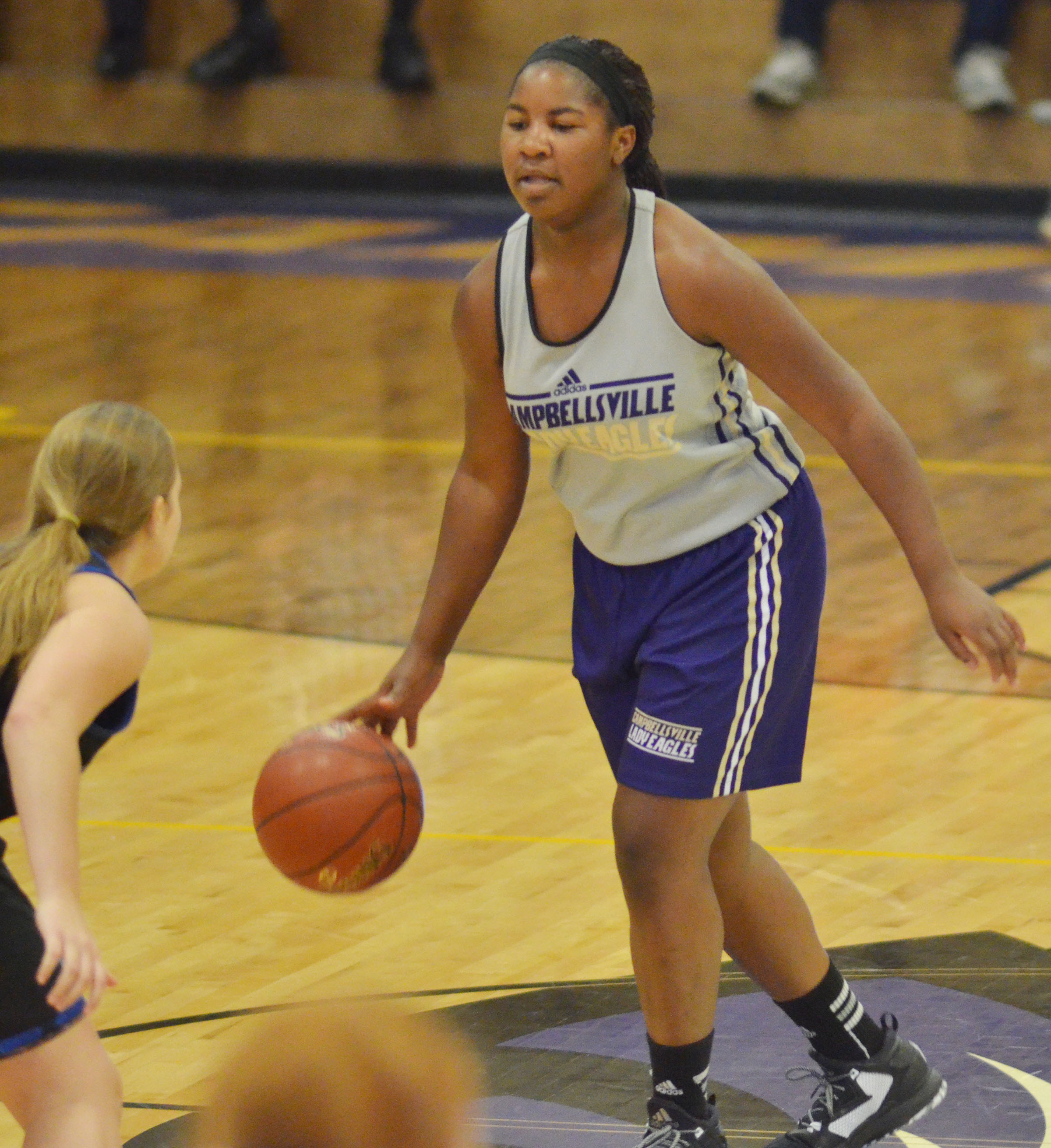 CHS junior Nena Barnett dribbles down the court.