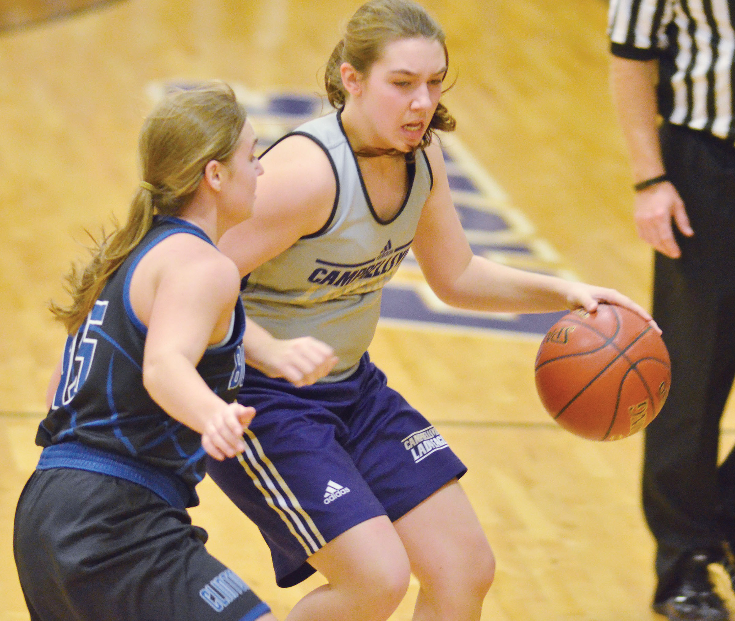 Campbellsville Middle School eighth-grader Abi Wiedewitsch protects the ball.