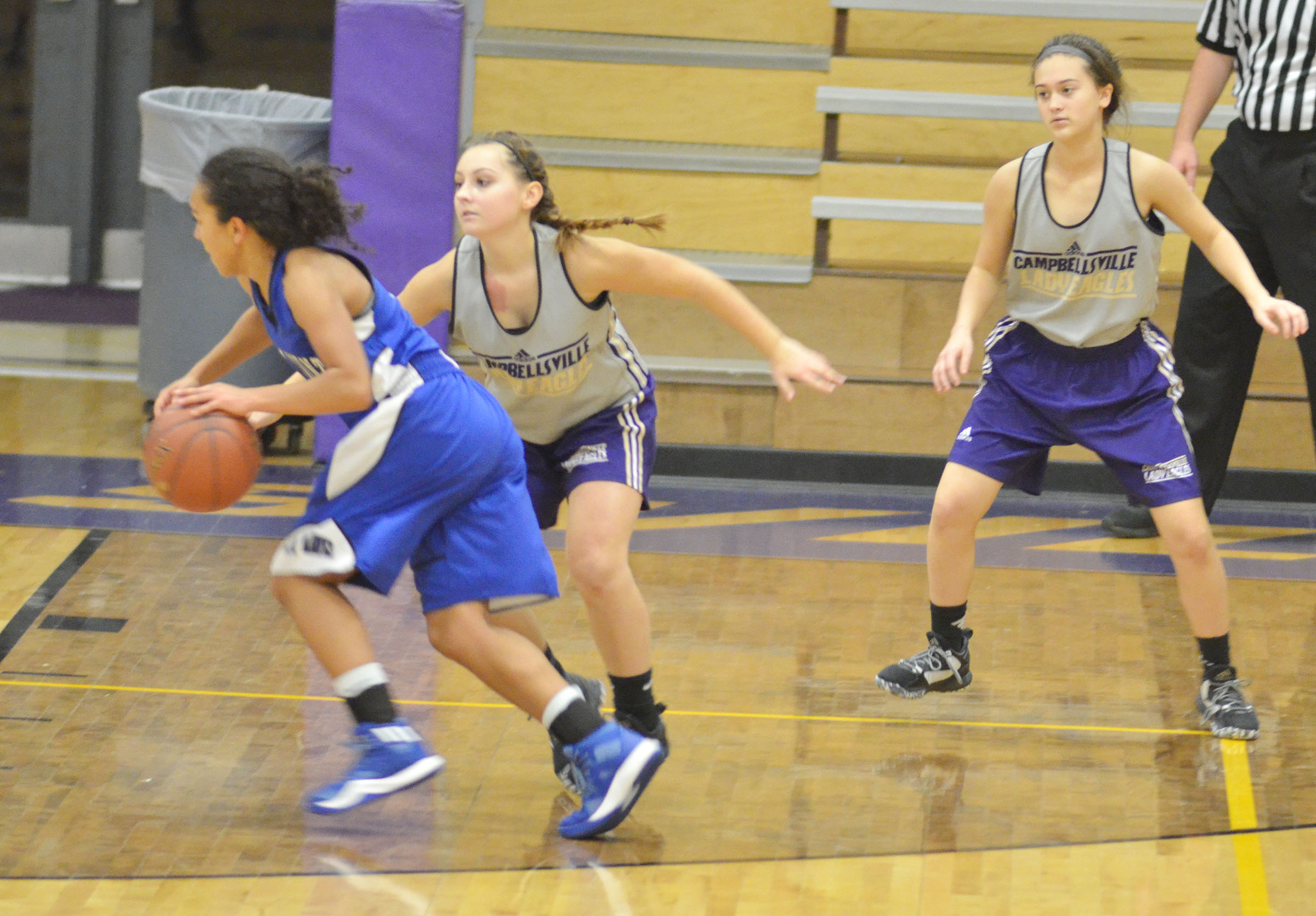 CHS sophomore Reagan Knight, at left, and freshman Bailey Thompson play defense.