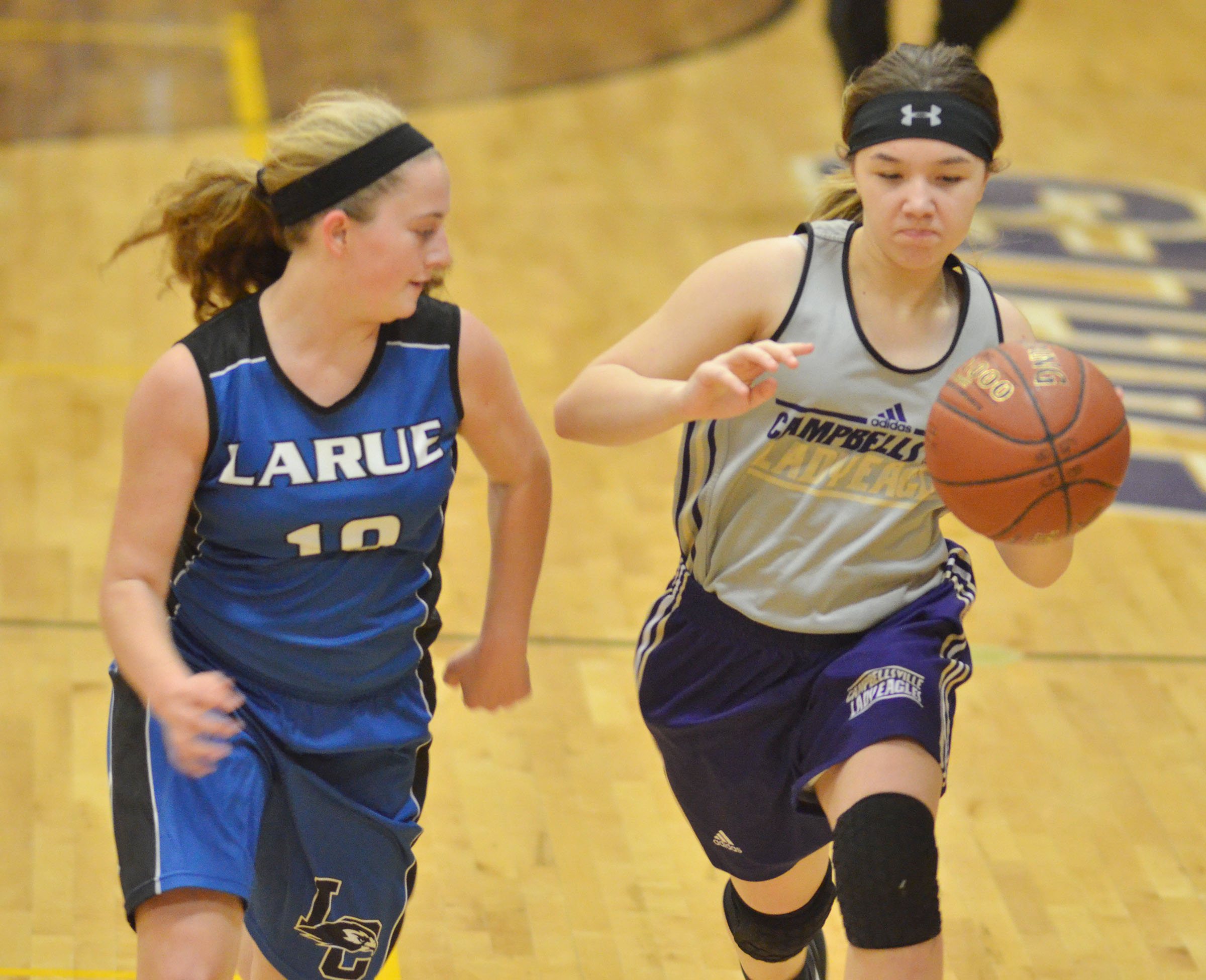 Campbellsville Middle School seventh-grader Olivia Fields dribbles to the basket.