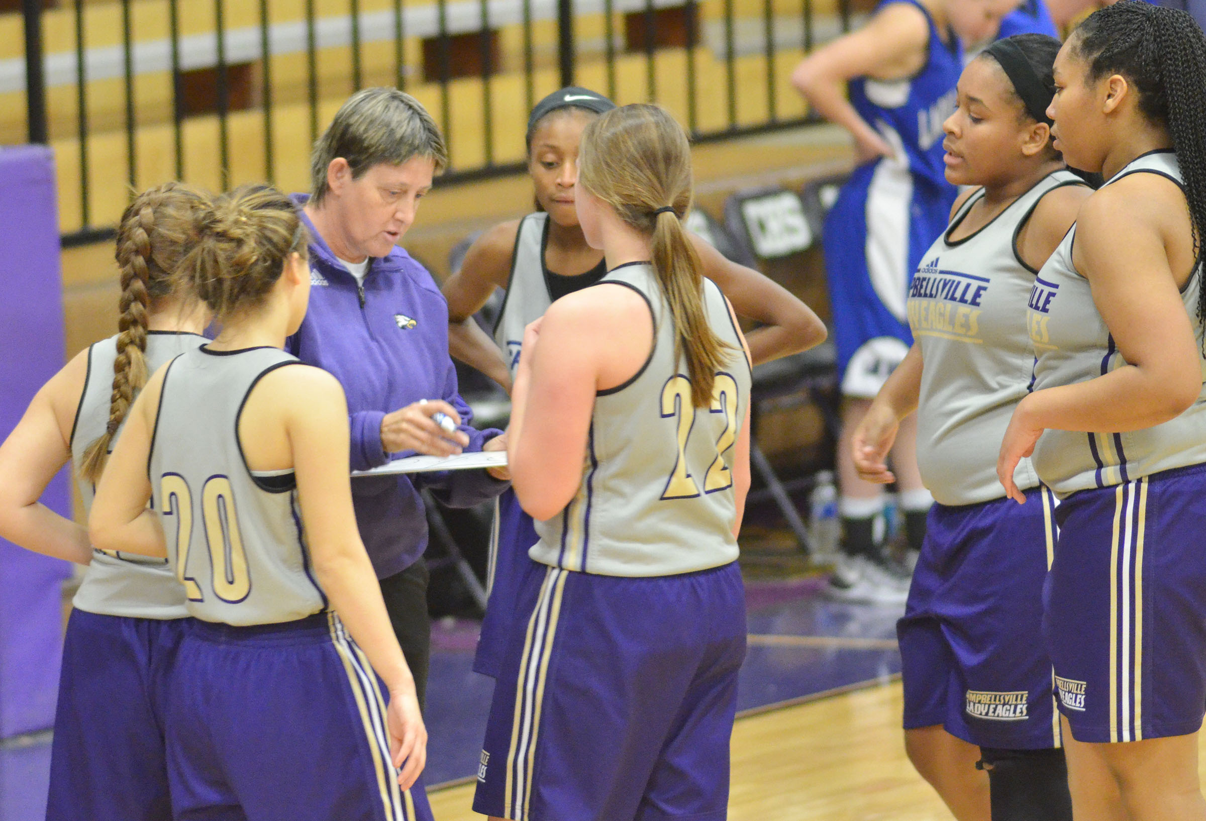 CHS girls' assistant basketball coach Katie Wilkerson talks to her players.