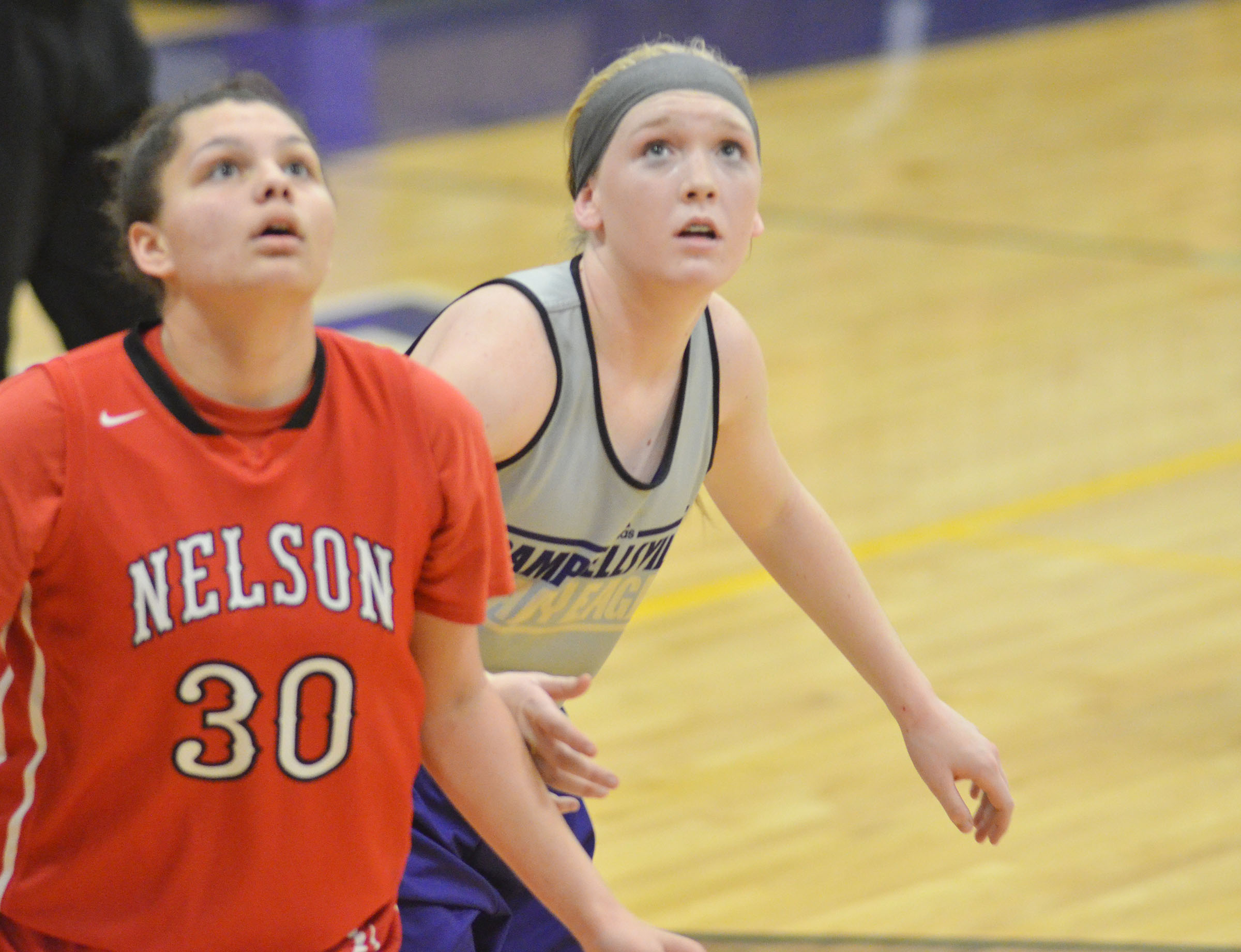 Campbellsville Middle School eighth-grader Catlyn Clausen looks for a rebound.