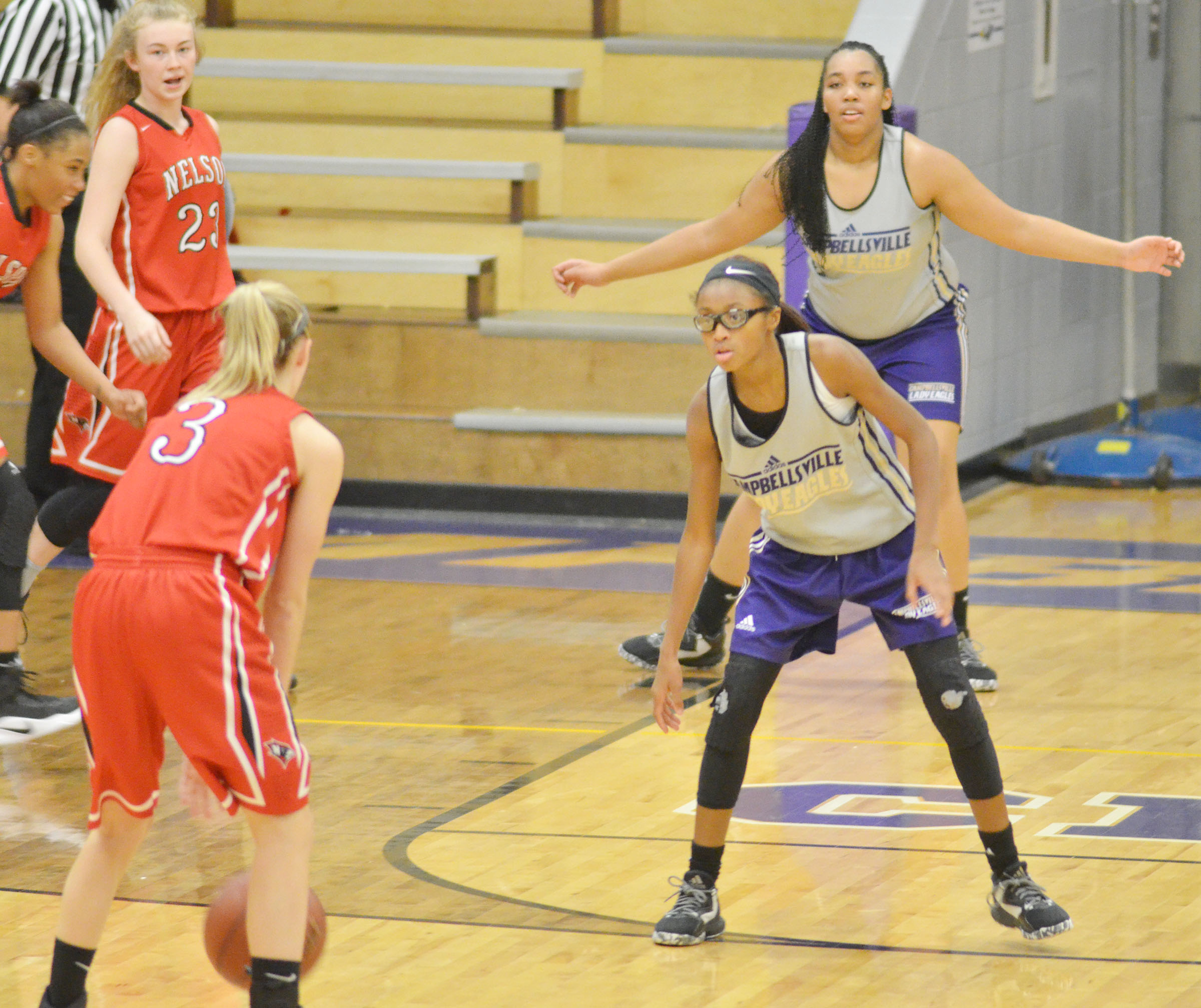 Campbellsville Middle School seventh-grader Bri Gowdy, in front, and CHS sophomore Malaya Hoskins play defense.