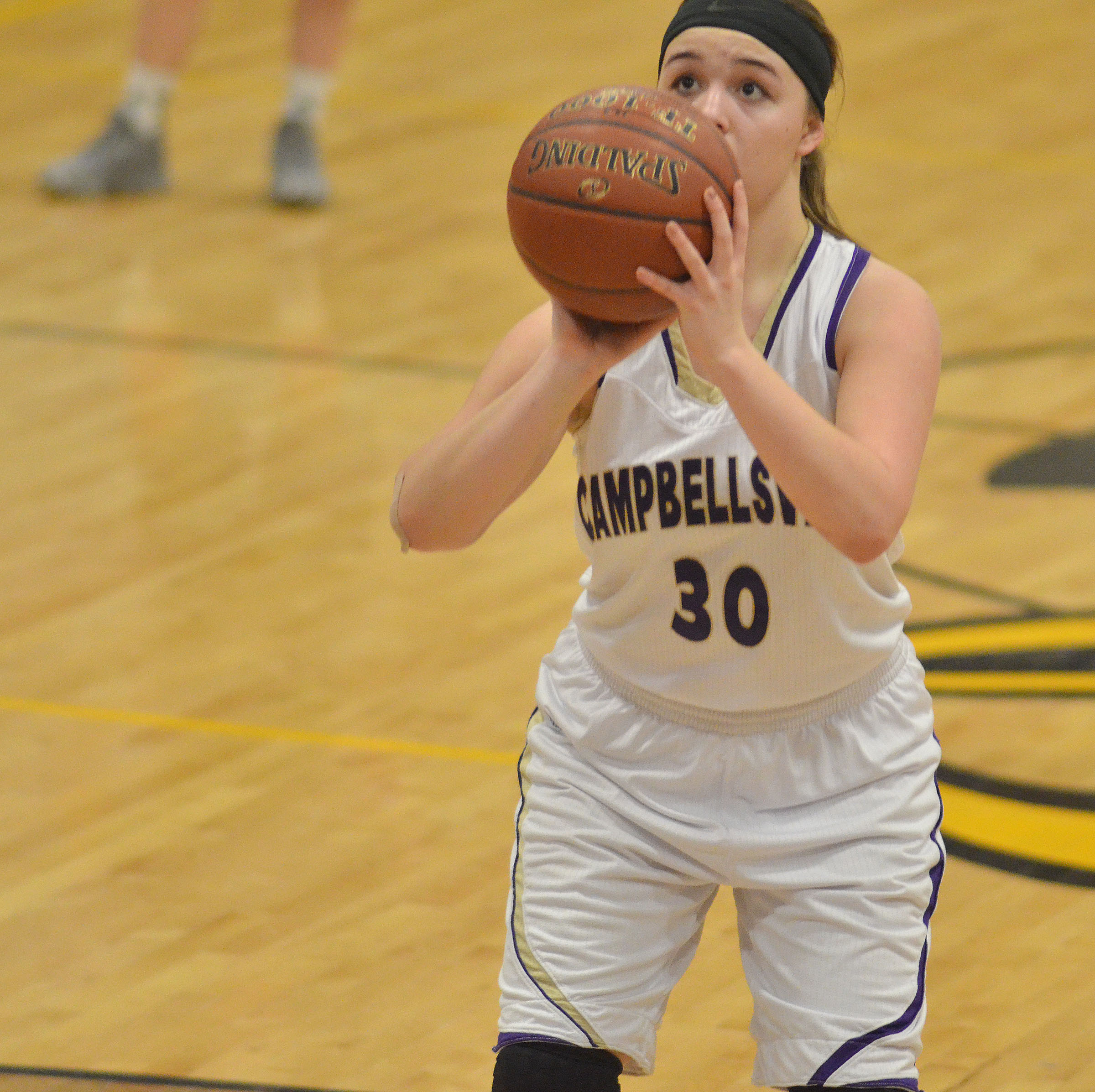 Campbellsville Middle School eighth-grader Kenzi Forbis shoots the ball.