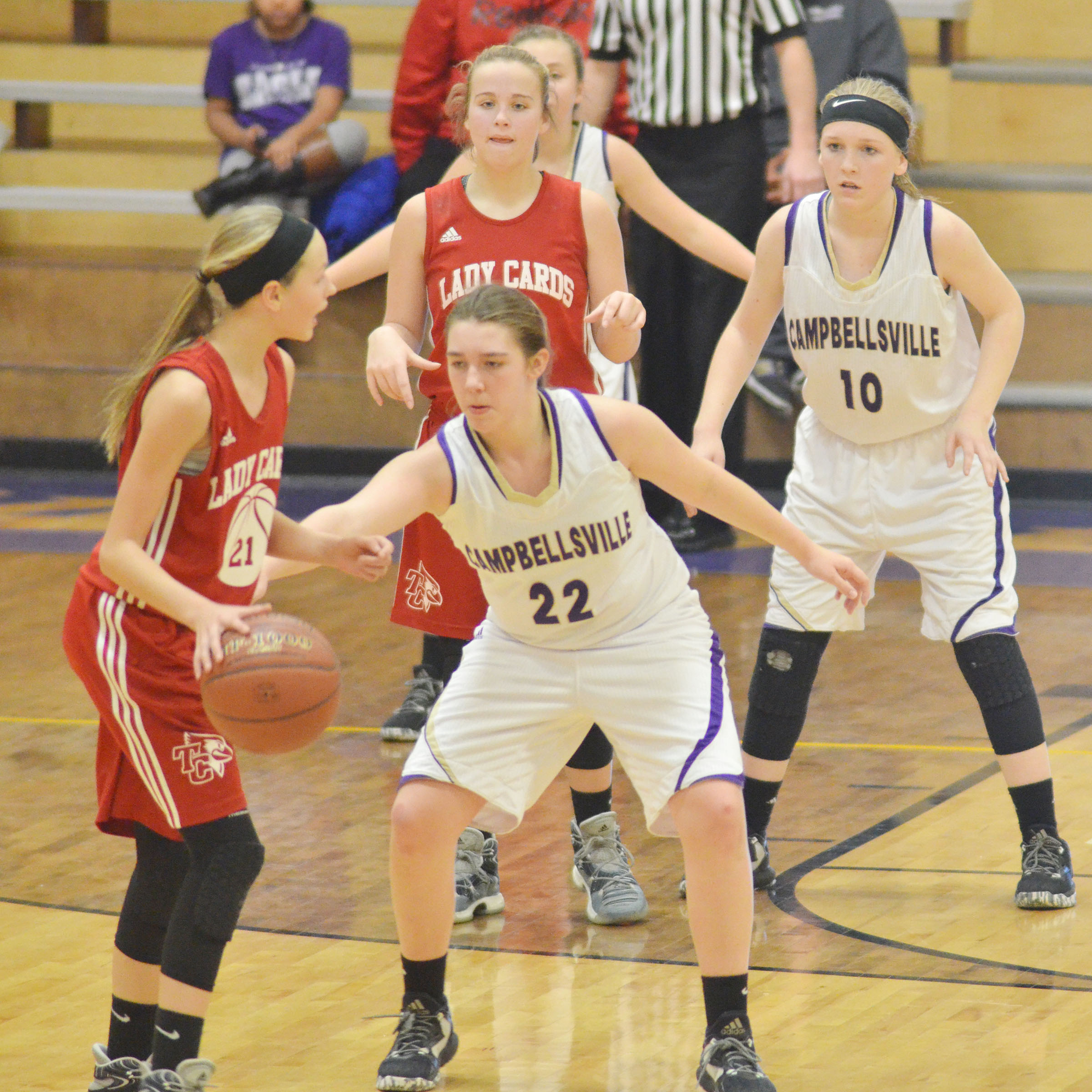 Campbellsville Middle School eighth-graders Abi Wiedewitsch, in front, and Catlyn Clausen play defense.
