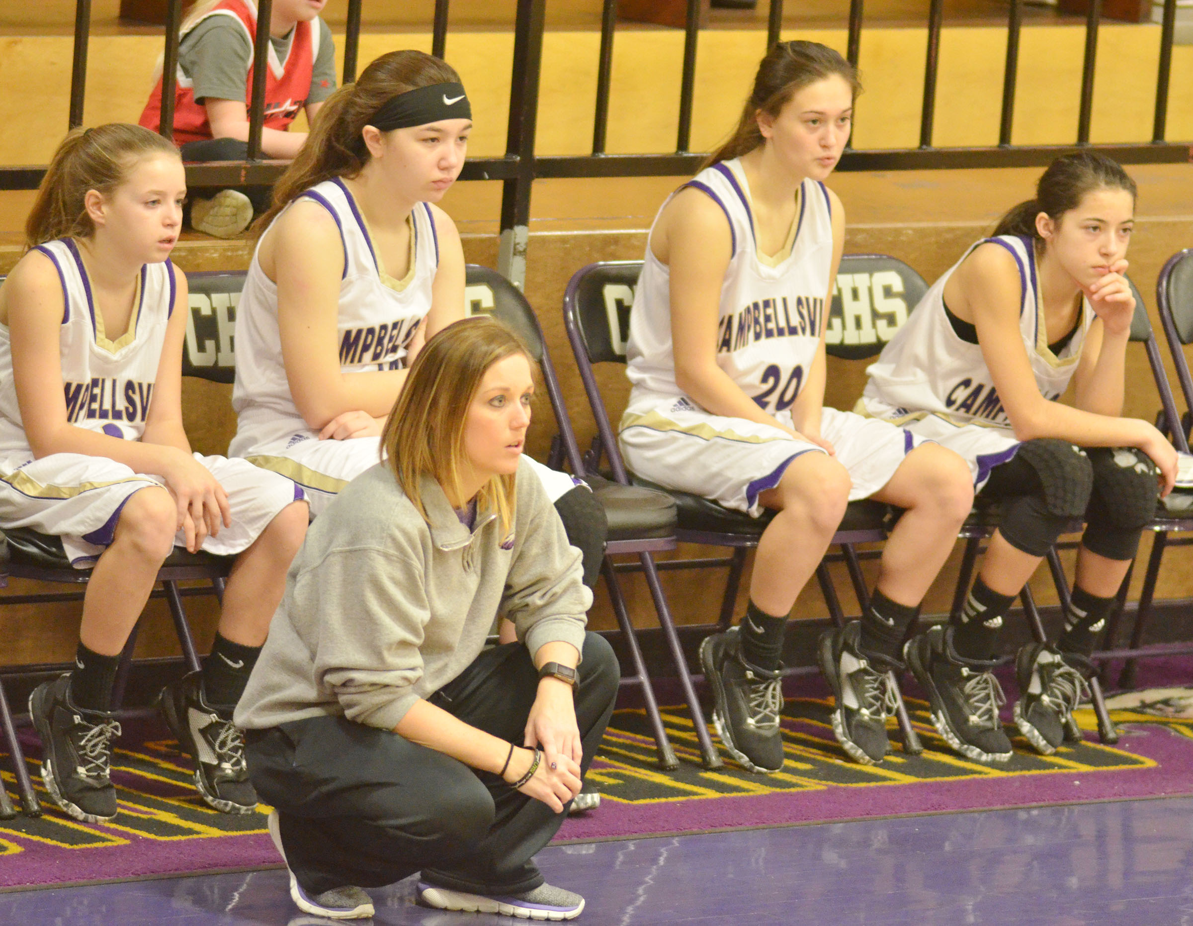 CHS girls' assistant basketball coach Natalia Warren watches as her team plays.