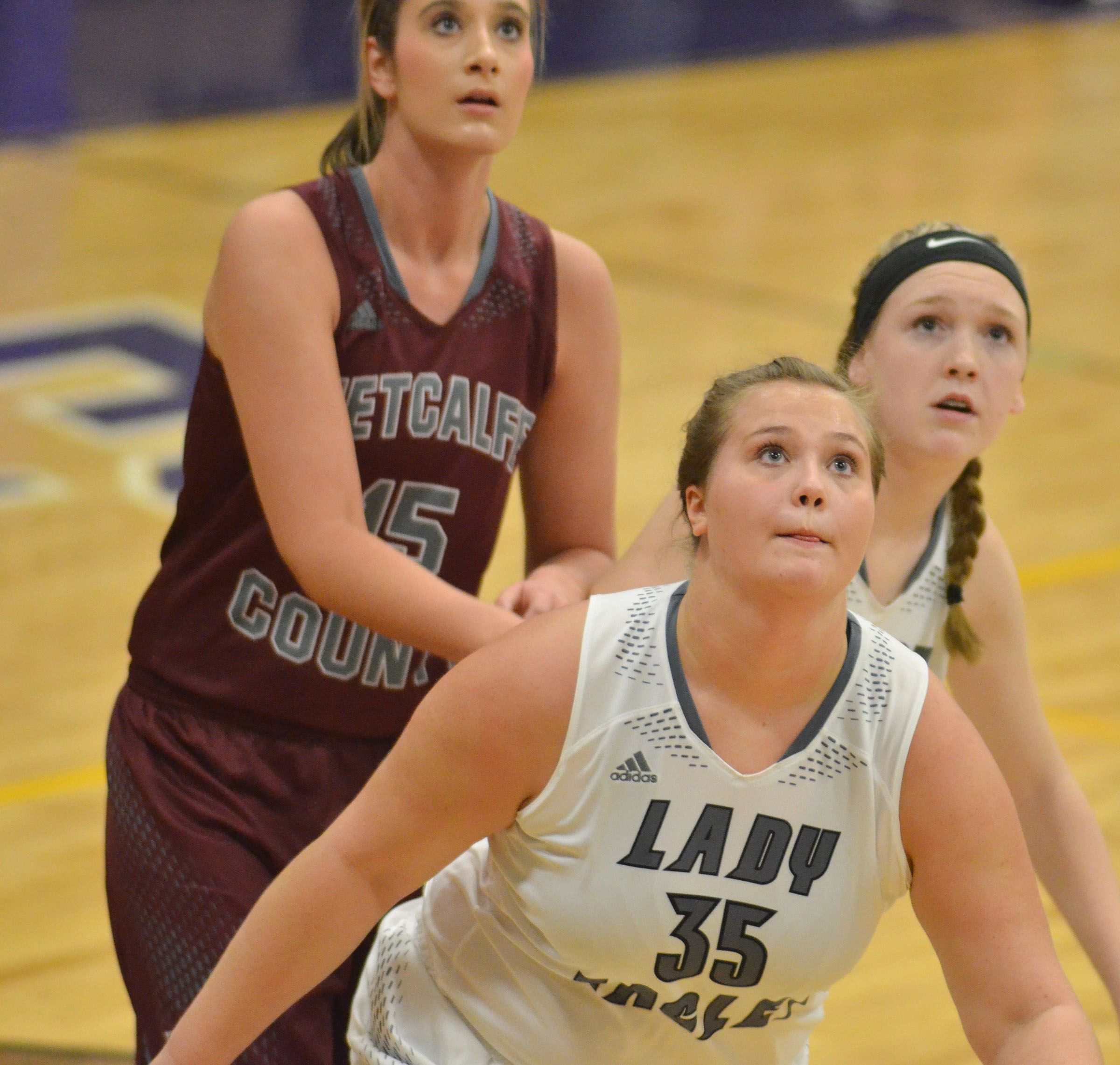 CHS senior Brenna Wethington and Campbellsville Middle School eighth-grader Catlyn Clausen, in back, look for a rebound.